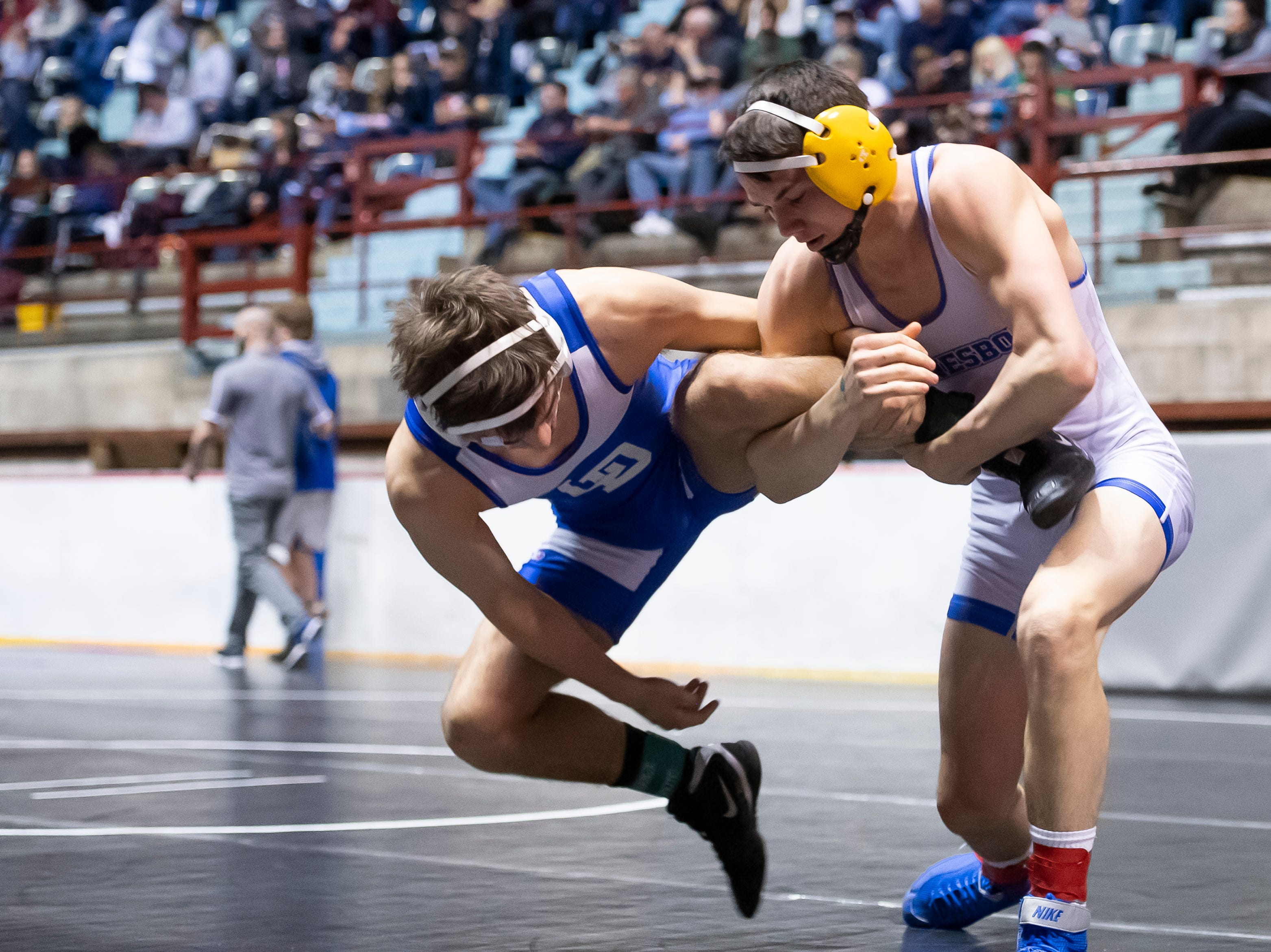 Waynesboro's Matt Mccann grabs the leg of Lower Dauphin's Troy-Thomas Elhajj during a 138-pound championship bout at the District 3 wrestling championships at Hersheypark Arena Saturday, February 23, 2019. Elhajj won by fall 2:51.