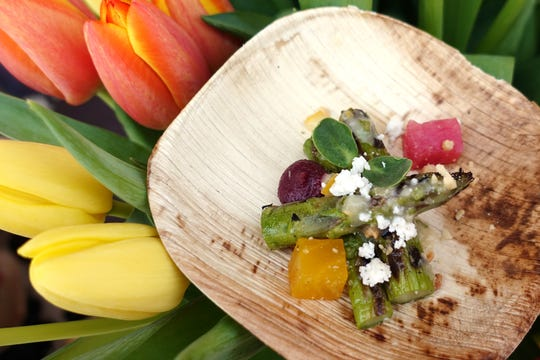 Chilled asparagus salad with McClendon's asparagus, Crow's Dairy feta, carrot puree, pickled beet, smoked almond and meyer lemon vinaigrette from Beckett's Table at the 2019 Devour Culinary Classic at the Desert Botanical Garden in Phoenix.