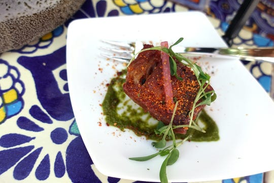 Crispy pork belly with spiced guava gelee, pickled onions and cilantro salsa verde from Deseo at the 2019 Devour Culinary Classic at the Desert Botanical Garden in Phoenix.