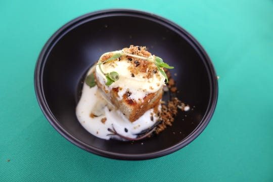 Sesame cake with citrus preserves, coconut cream, sesame crunch, toasted white chocolate, buttermilk ice cream and shiso from The Gladly at the 2019 Devour Culinary Classic at the Desert Botanical Garden in Phoenix.