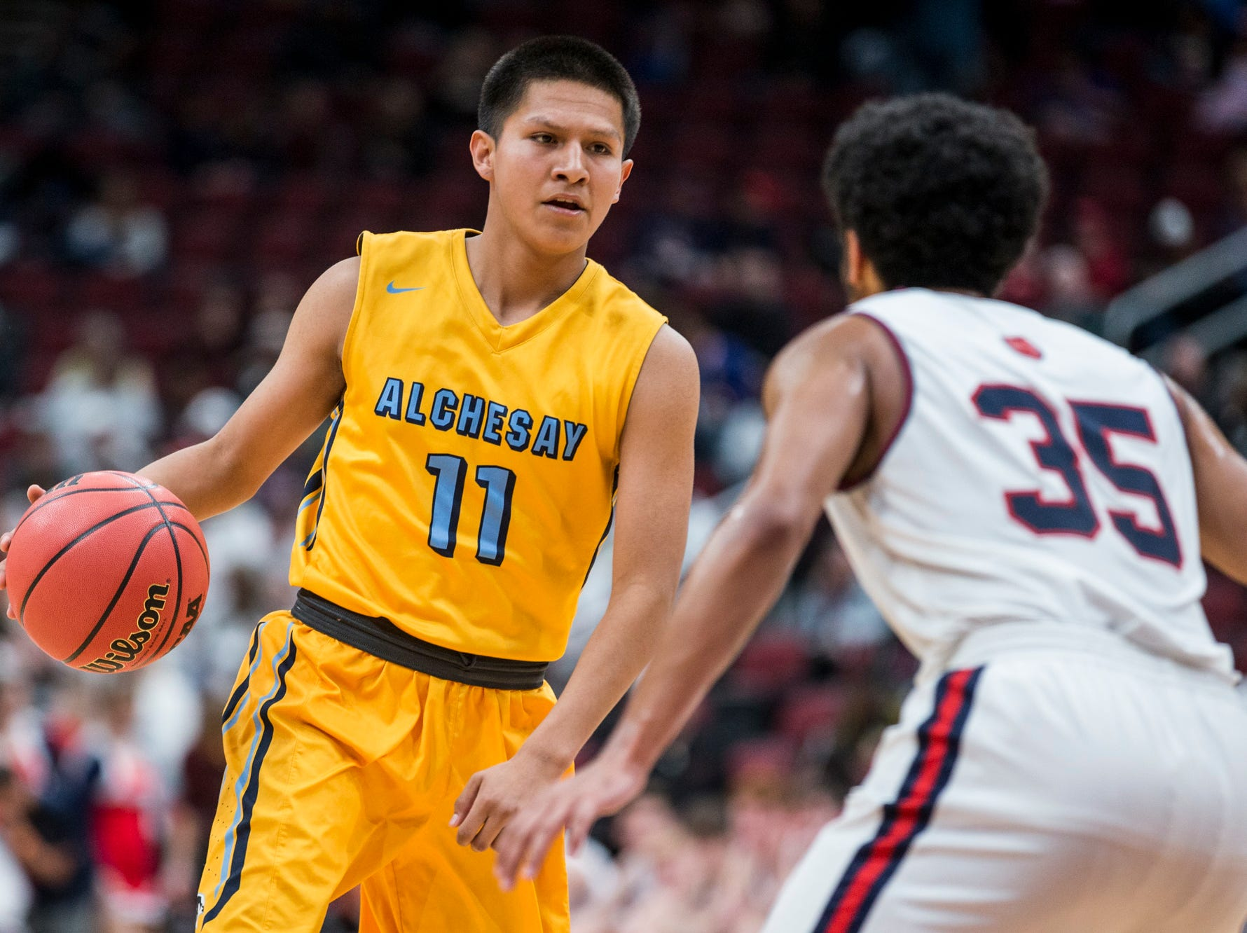 Alchesay's Shayne Stover sets up on offense against Scottsdale Christian during the 2A boys basketball championship on Saturday, Feb. 23, 2019, at Gila River Arena in Glendale, Ariz.