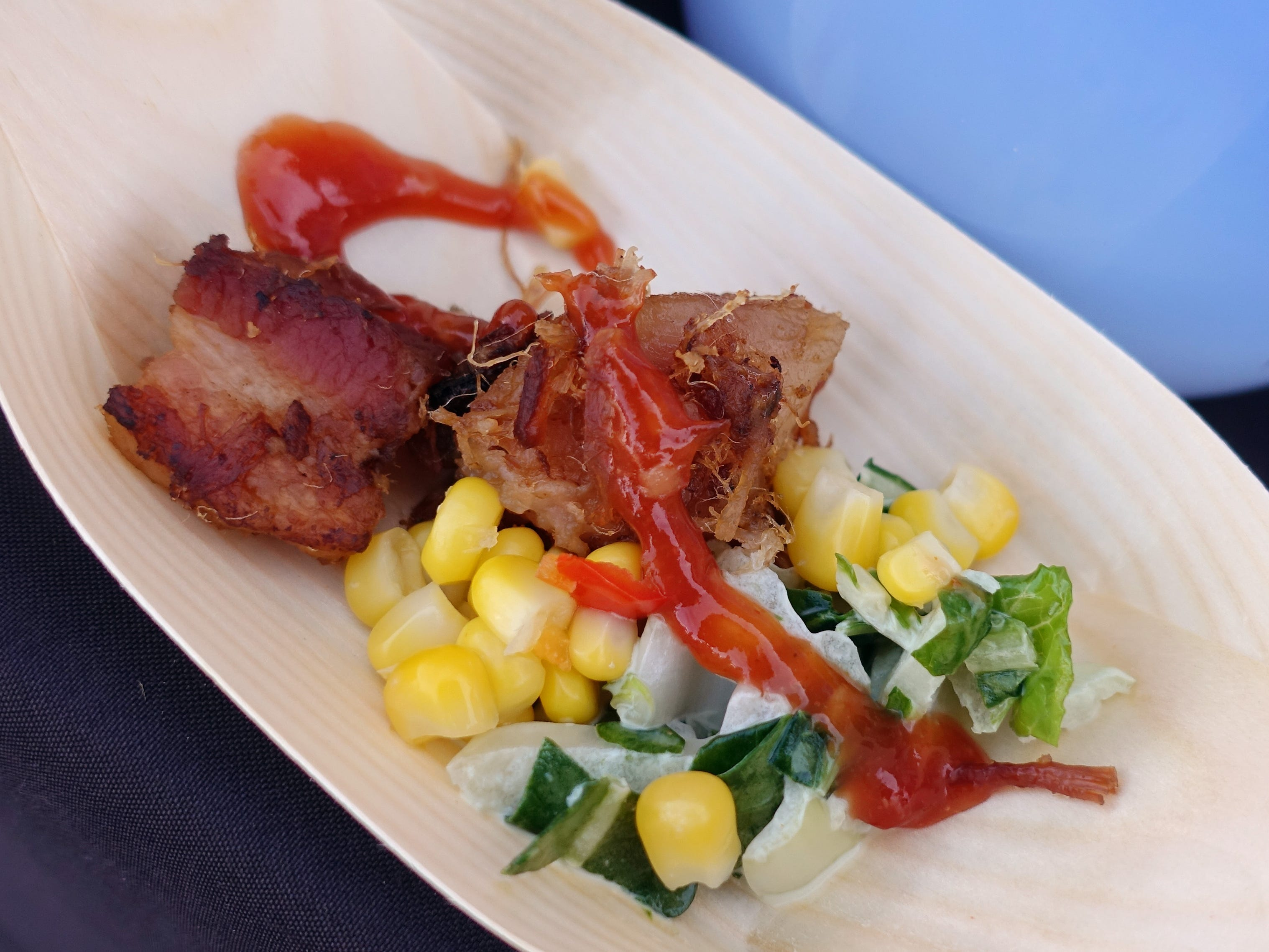 Berkshire pork belly with Thai chile barbecue sauce, preserved corn and bok choy honey slaw from Litchfield's at the 2019 Devour Culinary Classic at the Desert Botanical Garden in Phoenix.