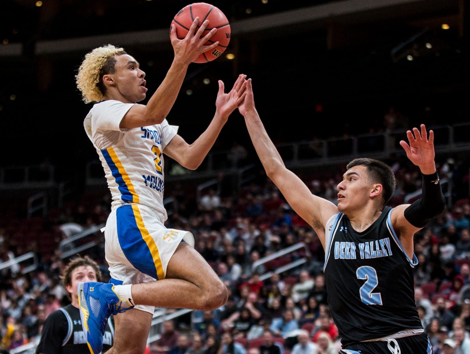 Shadow Mountain's Jaelen House attempts a layup against Deer Valley during the 4A boys basketball championship on Saturday, Feb. 23, 2019, at Gila River Arena in Glendale, Ariz.