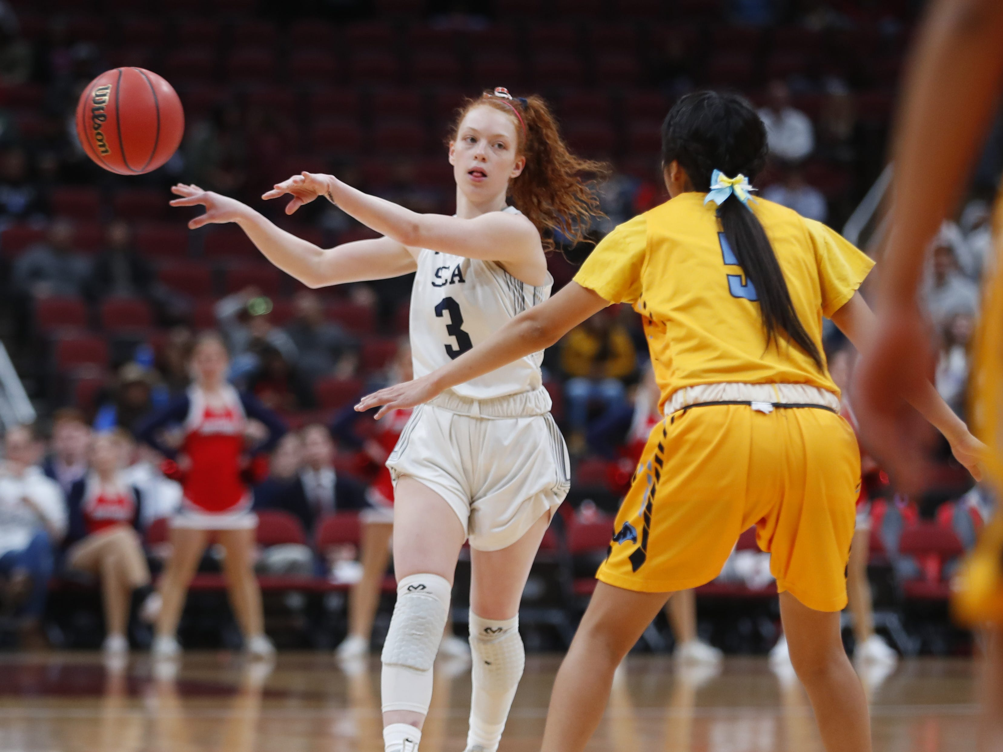 Scottsdale Christian's Kylie Hearn (3) dribbles against Alchesay's Shalicia Colelay (5) during the first half of the 2A girls basketball state championship game at Gila River Arena in Glendale, Ariz. on February 23, 2019.