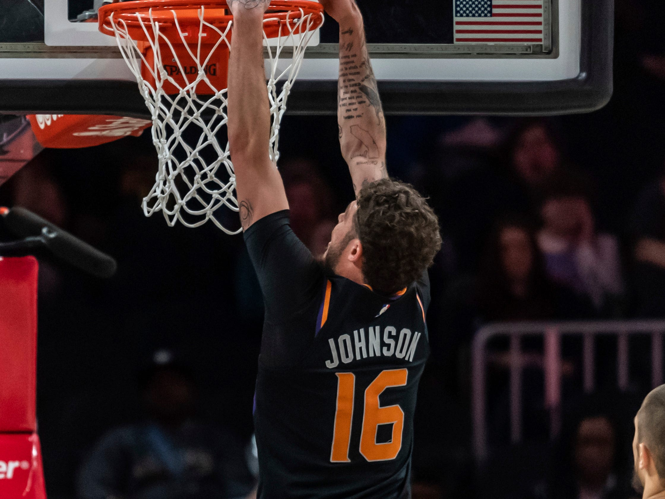 Phoenix Suns guard Tyler Johnson (16) dunks during the first half of an NBA basketball game against the Atlanta Hawks Saturday, Feb. 23, 2019, in Atlanta.