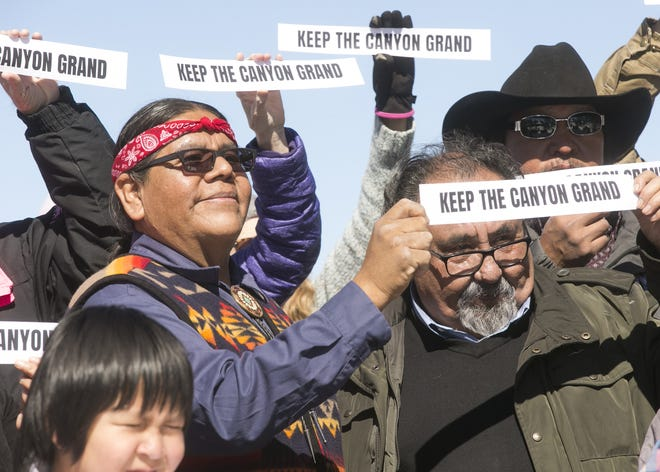 """Havasupai Tribal Council Vice Chairman Matthew Putesoy (left) and U.S. Rep. Raúl Grijalva hold signs reading """"Keep the Canyon Grand"""" at the Grand Canyon on Saturday, Feb. 23, 2019. Efforts are anew in the Congress to permanently ban uranium mining in the Canyon area."""