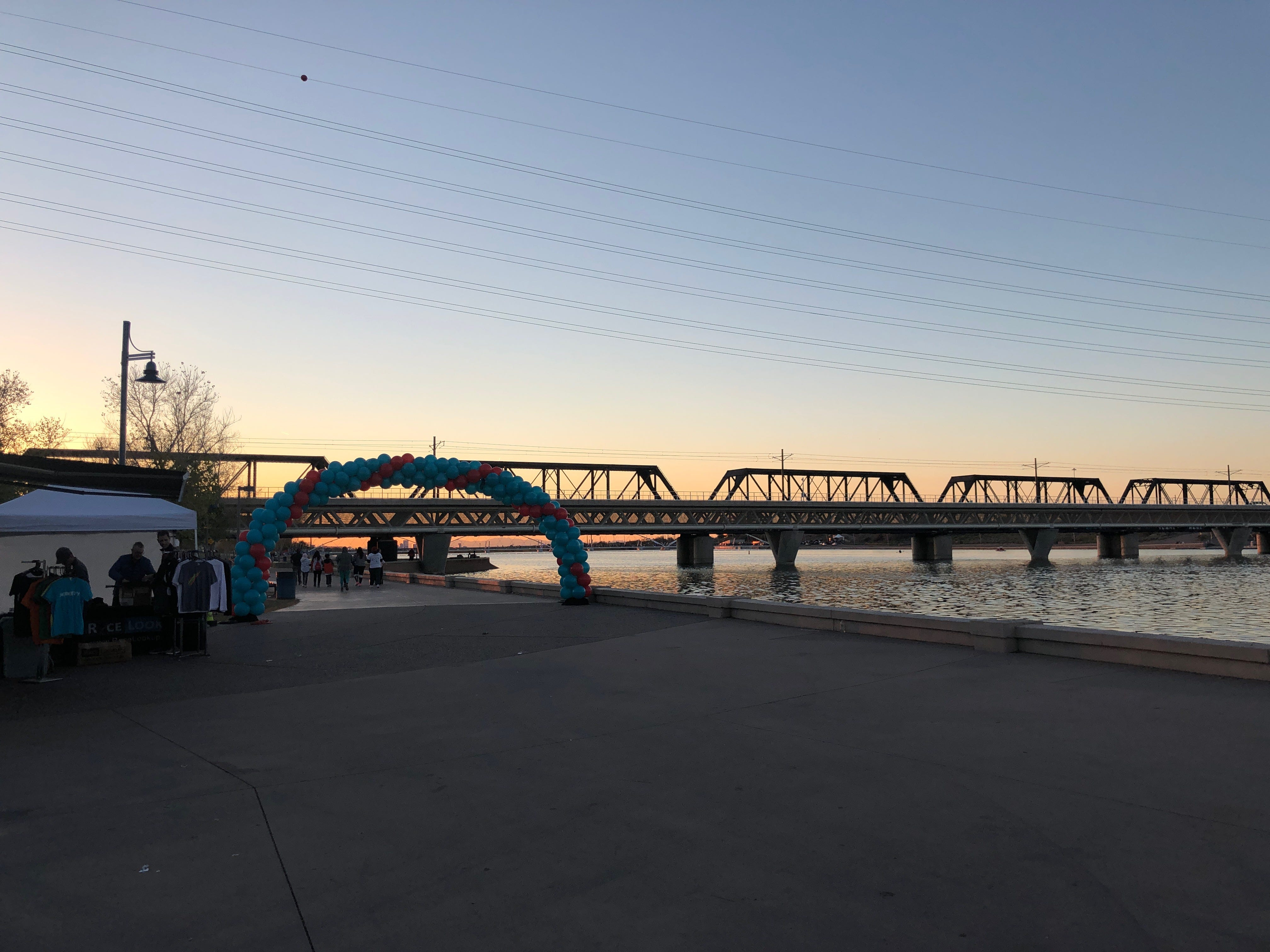 The sun sets over the 5K course as walkers set out to walk in the 2019 AIDS Walk Arizona.