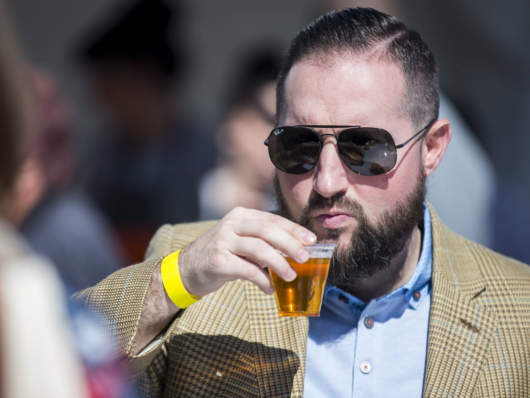 Dom Nelson drinks a beer during Day 1 of the Devour Culinary Classic on Saturday, Feb. 23, 2019, at Desert Botanical Garden in Phoenix.
