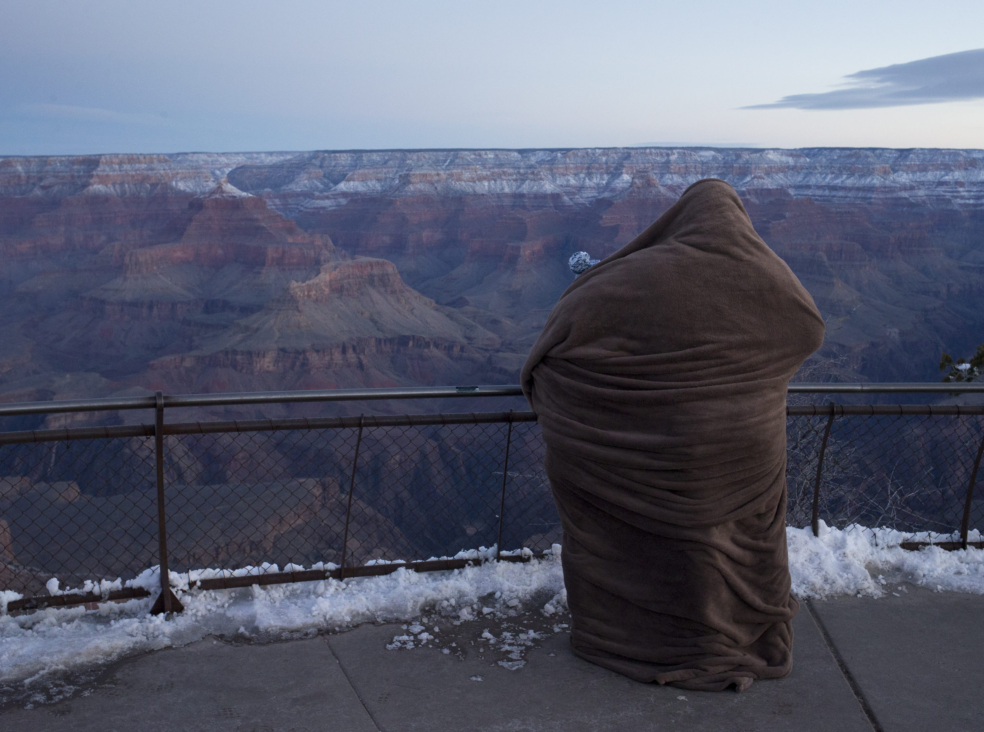 Visitors bundled up to view the sunrise at Mather Point at the South Rim of Grand Canyon National Park, Ariz., on Feb. 20, 2019.