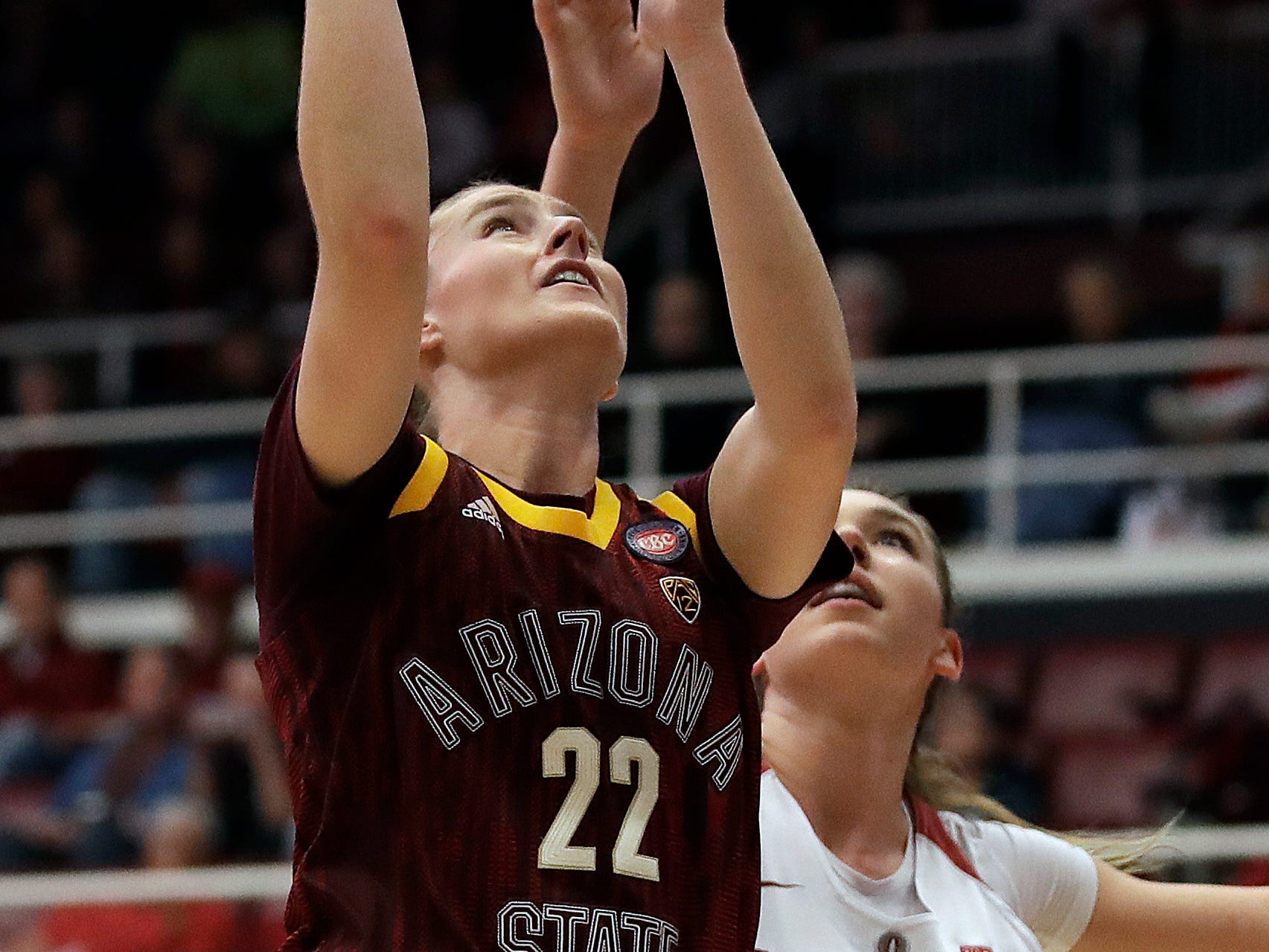 Arizona State's Courtney Ekmark (22) shoots past Stanford's Alanna Smith, right, during the first half of an NCAA college basketball game Sunday, Feb. 24, 2019, in Stanford, Calif.
