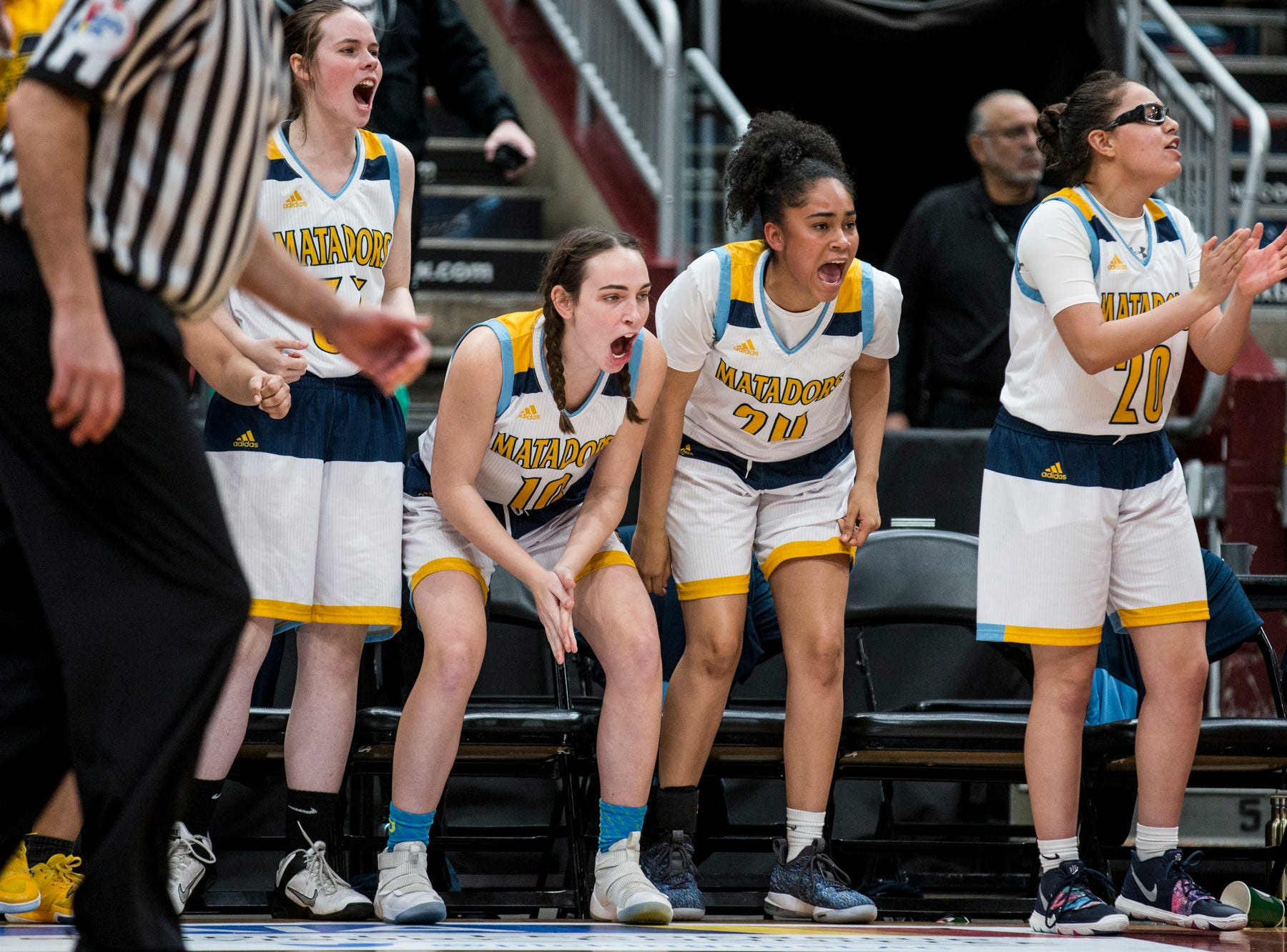 Shadow Mountain's bench cheers during the 4A girls basketball championship against Seton Catholic on Saturday, Feb. 23, 2019, at Gila River Arena in Glendale, Ariz.