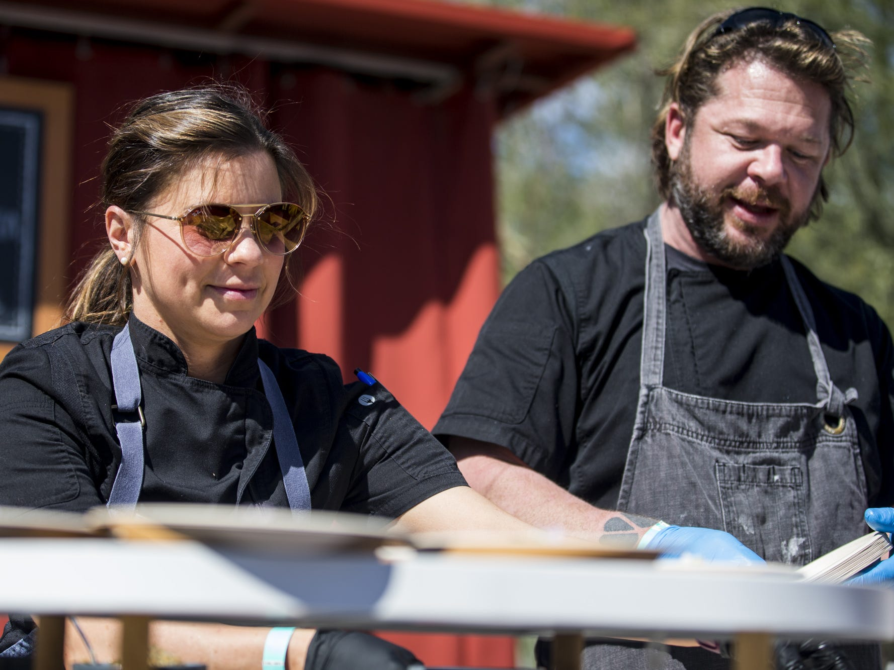 Rochelle Daniel and Chops Smith of Fat Ox serve samples during Day 1 of the Devour Culinary Classic on Saturday, Feb. 23, 2019, at Desert Botanical Garden in Phoenix.