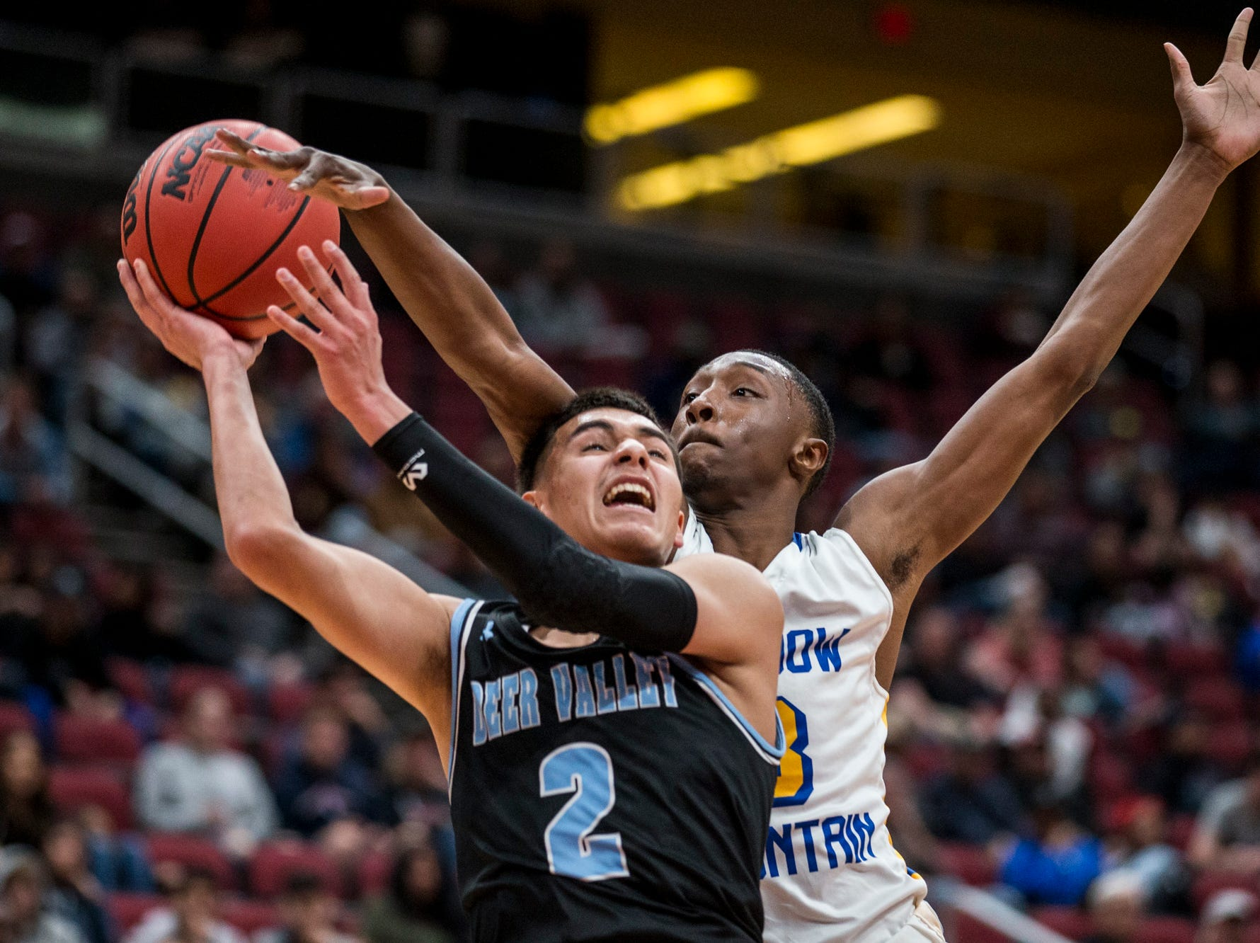 Shadow Mountain's Devotes Cobbs tries to block Deer Valley's Johny Diaz's shot during the 4A boys basketball championship on Saturday, Feb. 23, 2019, at Gila River Arena in Glendale, Ariz.