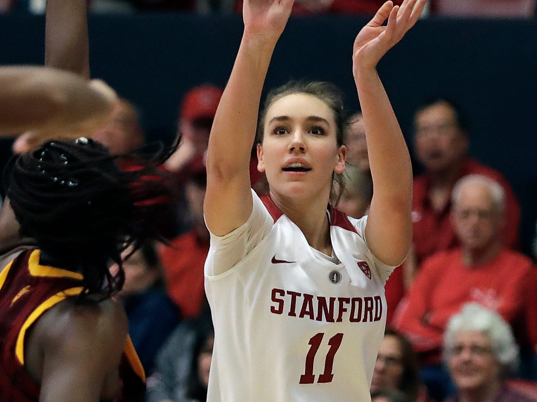 Stanford's Alanna Smith (11) shoots over Arizona State's Sophia Elenga during the second half of an NCAA college basketball game Sunday, Feb. 24, 2019, in Stanford, Calif.