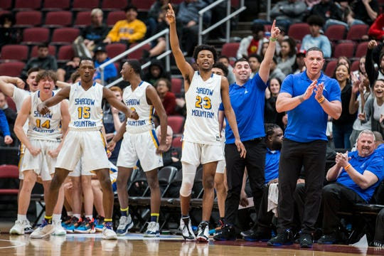 Shadow Mountain's bench cheers during the 4A boys basketball championship against Deer Valley on Saturday, Feb. 23, 2019, at Gila River Arena in Glendale, Ariz.