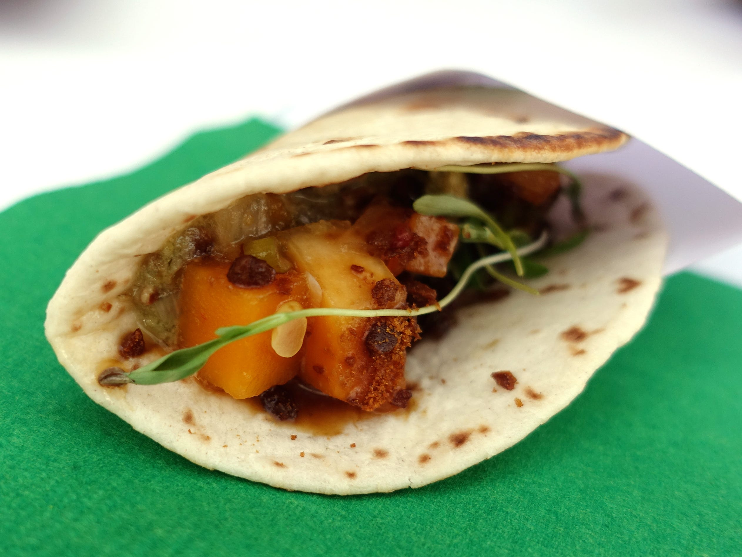 Molasses candied beef cheek taco with fermented butternut squash and pepita salsa from House of Tricks at the 2019 Devour Culinary Classic at the Desert Botanical Garden in Phoenix.