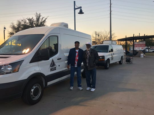 Free HIV testing was available on site through Ebony House Incorporated. Workers Abdul Hasan and William Becketts pose outside the trucks hosting the testing.