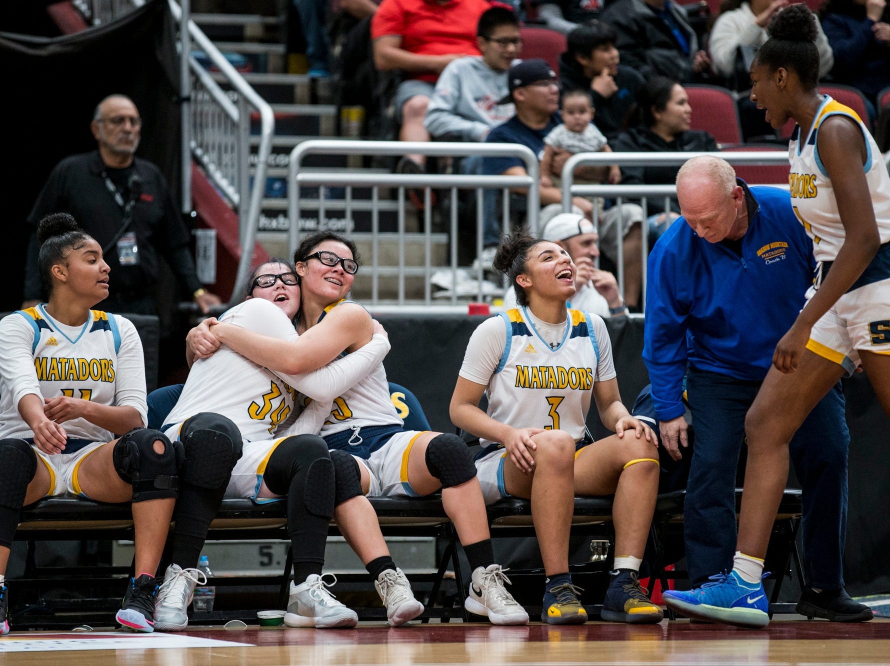 Shadow Mountain's bench celebrates before defeating Seton Catholic for the 4A girls basketball championship on Saturday, Feb. 23, 2019, at Gila River Arena in Glendale, Ariz.