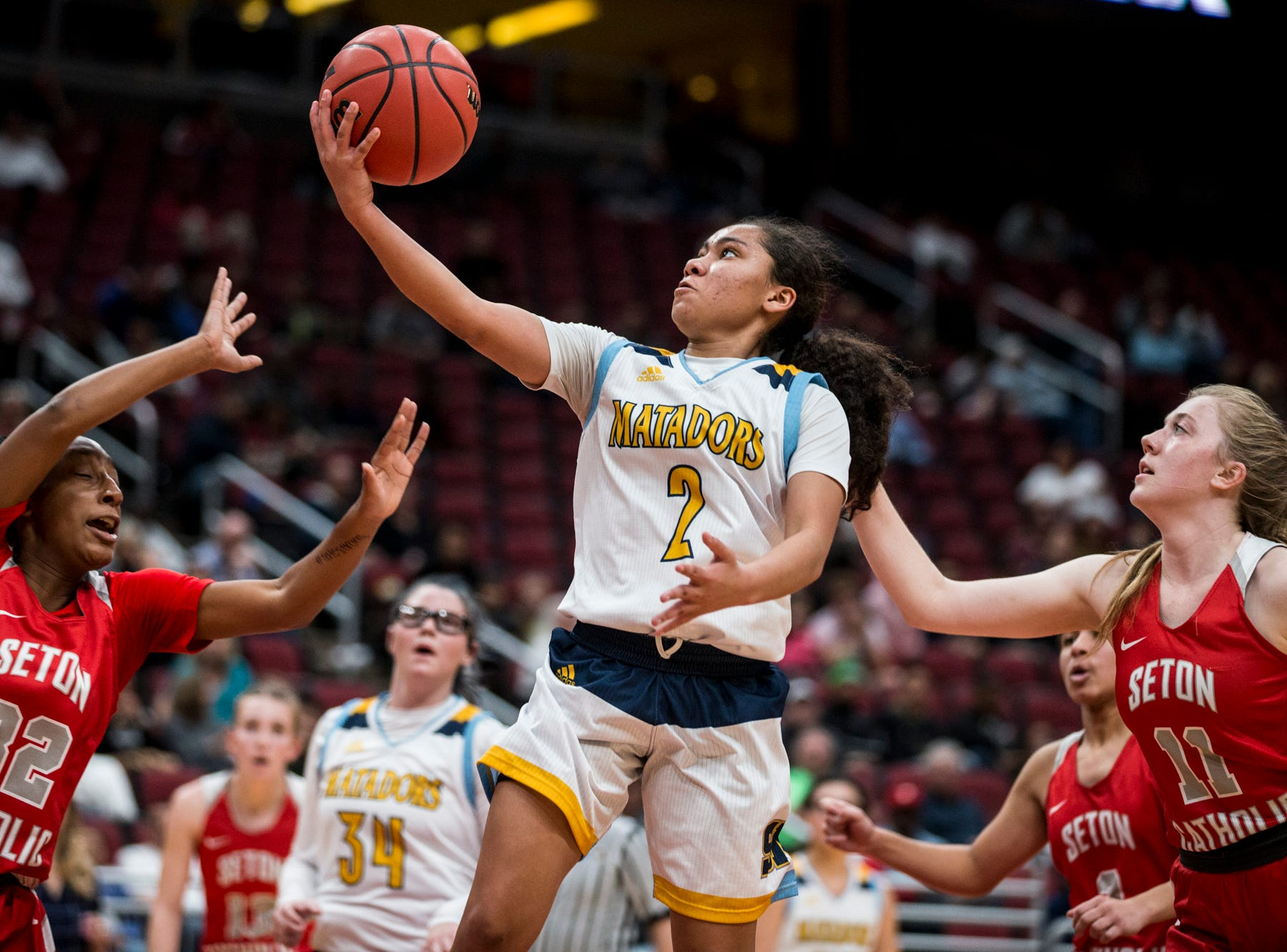Shadow Mountain's Senya Rabouin attempts a layup against Seton Catholic during the 4A girls basketball championship on Saturday, Feb. 23, 2019, at Gila River Arena in Glendale, Ariz.