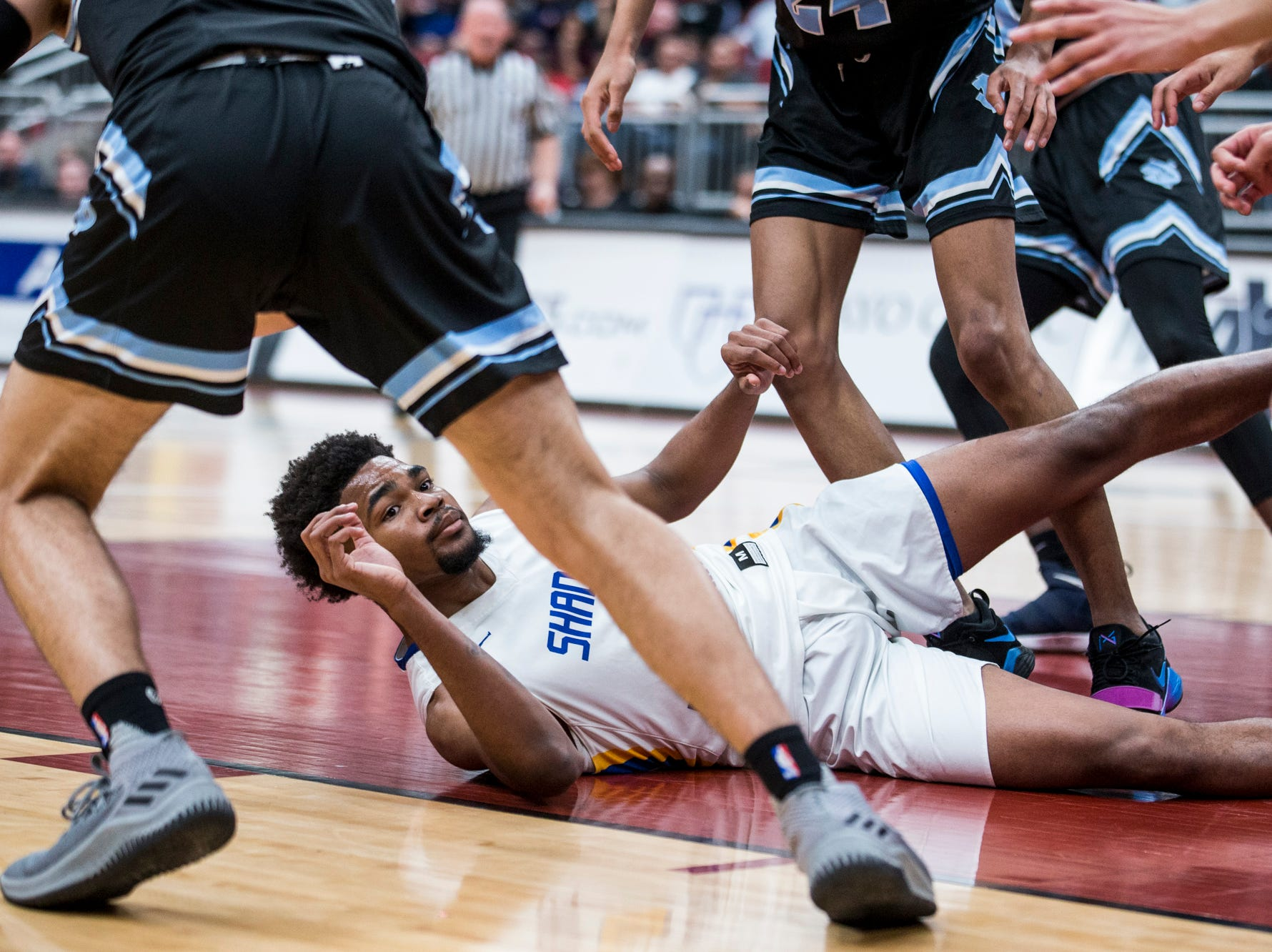 Shadow Mountain's Jalen Williams lies on the ground during a play against Deer Valley during the 4A boys basketball championship on Saturday, Feb. 23, 2019, at Gila River Arena in Glendale, Ariz.