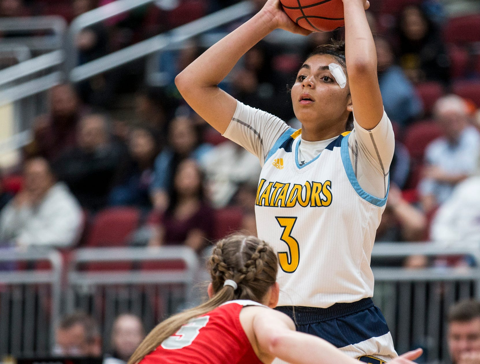 Shadow Mountain's Zhane Jordan looks to pass against Seton Catholic during the 4A girls basketball championship on Saturday, Feb. 23, 2019, at Gila River Arena in Glendale, Ariz.