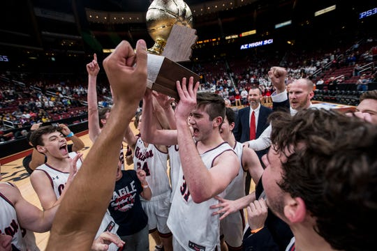 Scottsdale Christian celebrates after defeating Alchesay for the 2A boys basketball championship on Saturday, Feb. 23, 2019, at Gila River Arena in Glendale, Ariz.