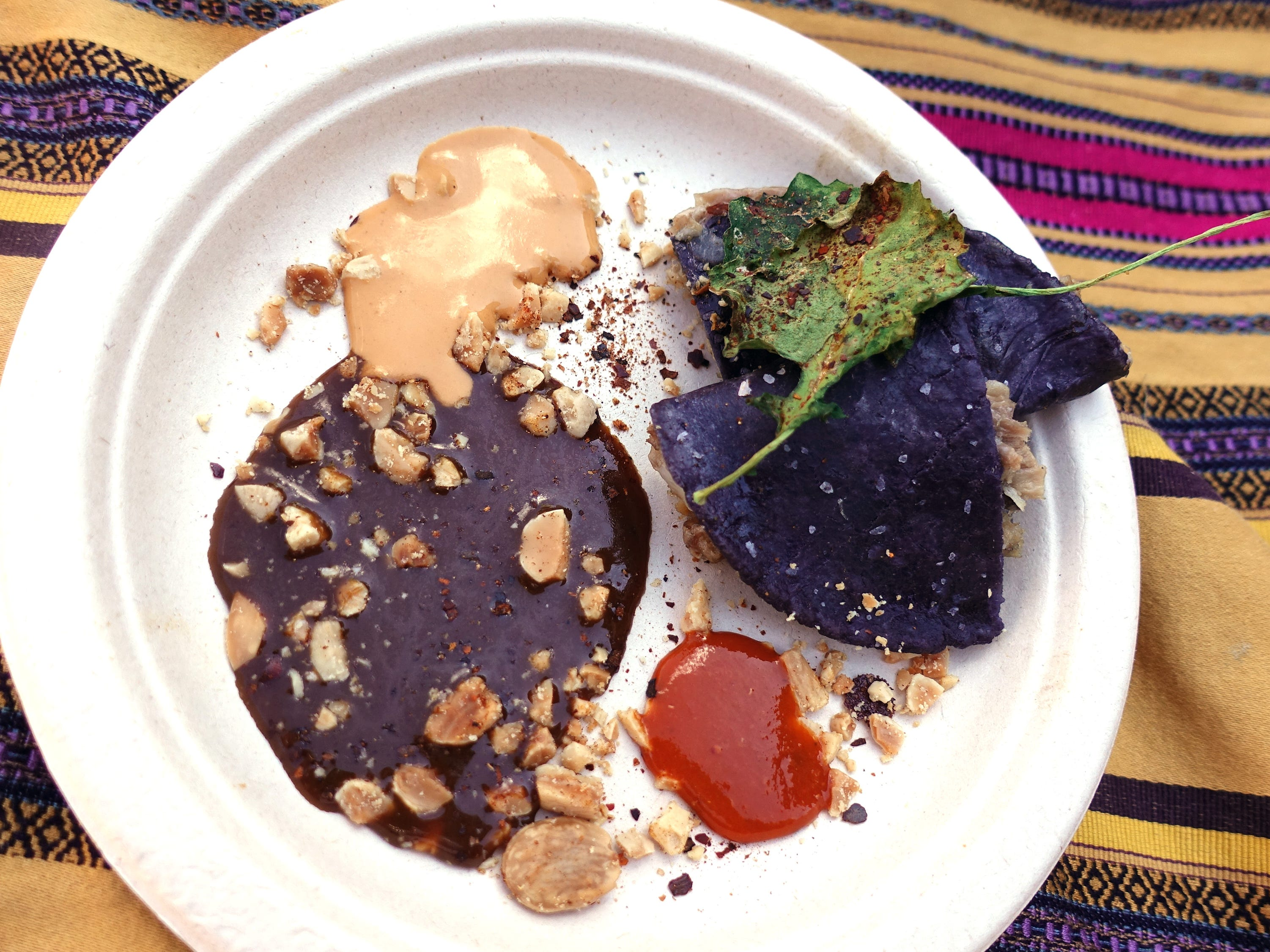Duck carnitas quesadilla with blue corn masa, smoked mushrooms, marcona almond, crispy kale, peanut guajillo mole glaze and chiltepin salsas from The Mission at the 2019 Devour Culinary Classic at the Desert Botanical Garden in Phoenix.