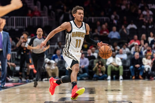 Atlanta Hawks guard Trae Young (11) drives to the basket during the first half of an NBA basketball game against the Phoenix Suns Saturday, Feb. 23, 2019, in Atlanta.