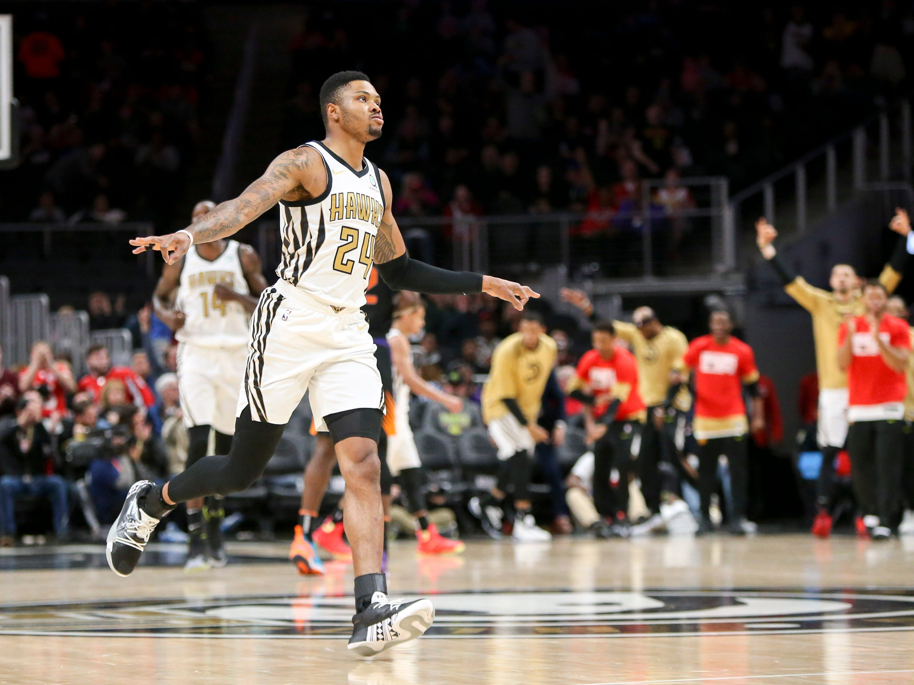 Feb 23, 2019: Atlanta Hawks guard Kent Bazemore (24) reacts after a made three-pointer against the Phoenix Suns in the first quarter at State Farm Arena.