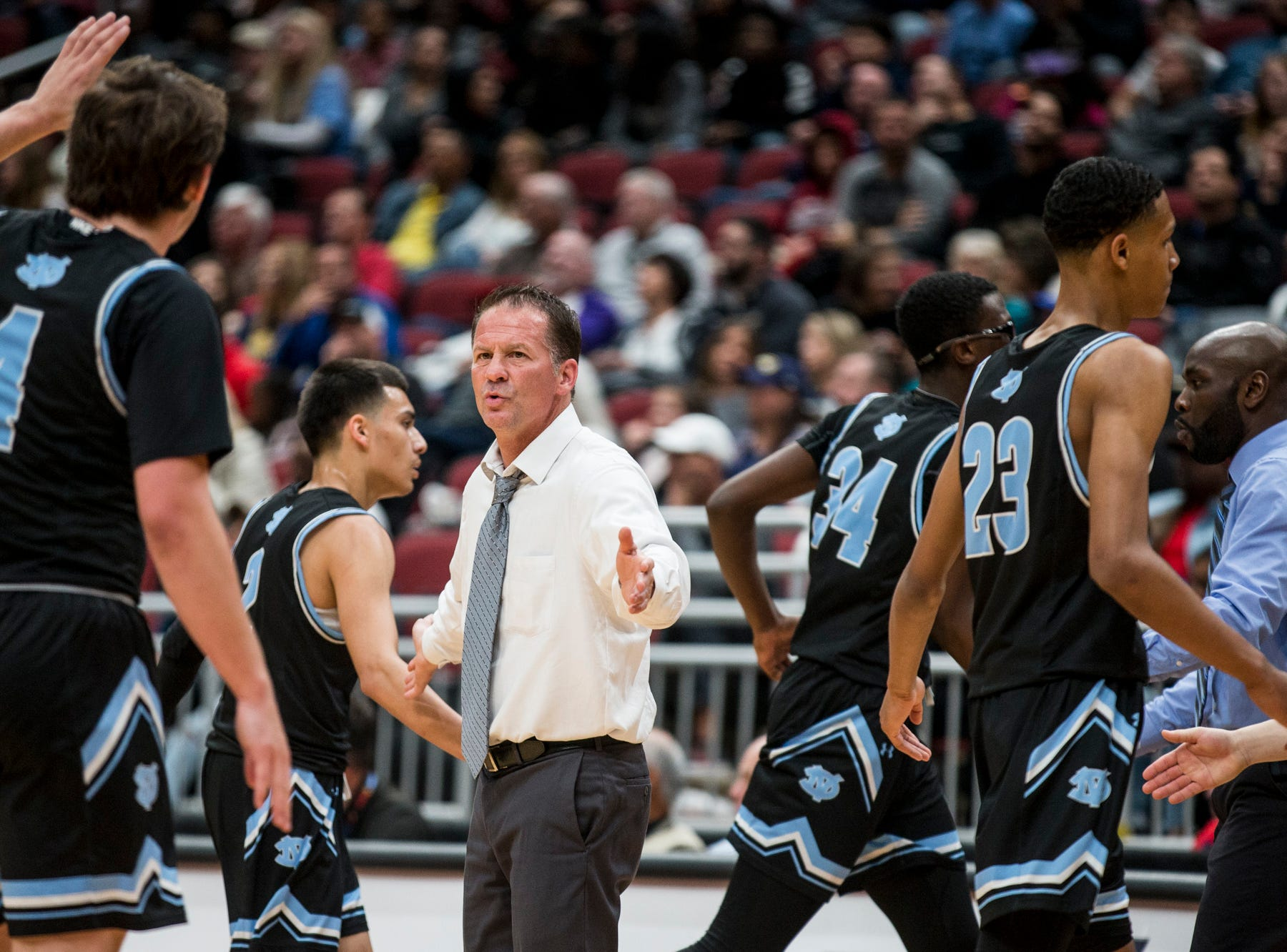Deer Valley head coach Jed Dunn talks to players during a timeout during the 4A boys basketball championship on Saturday, Feb. 23, 2019, at Gila River Arena in Glendale, Ariz.
