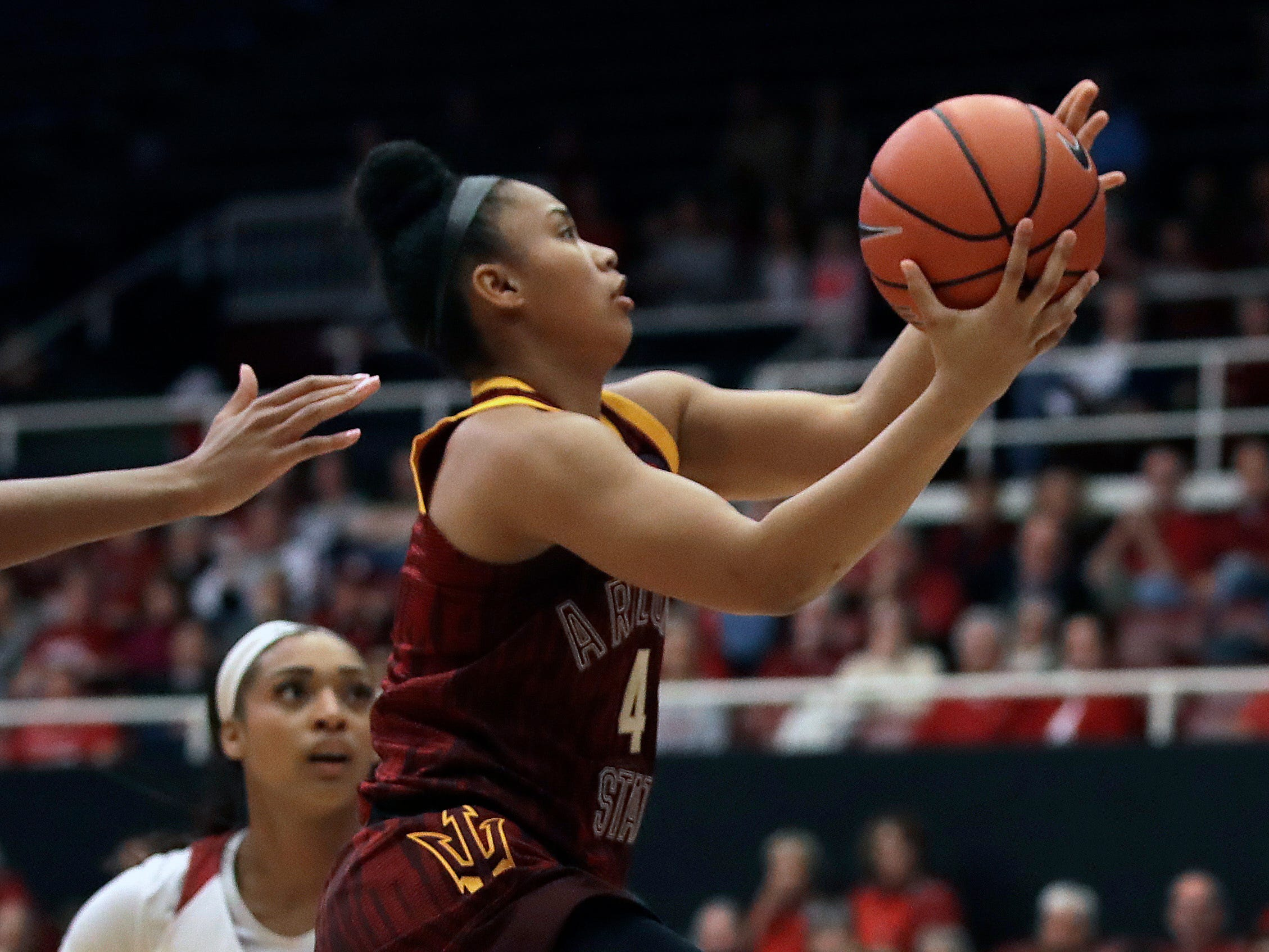 Arizona State's Kiara Russell, right, shoots past Stanford's DiJonai Carrington (21) during the first half of an NCAA college basketball game Sunday, Feb. 24, 2019, in Stanford, Calif.