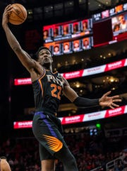 Phoenix Suns center Deandre Ayton (22) rebounds the ball during the first half of an NBA basketball game against the Atlanta Hawks Saturday, Feb. 23, 2019, in Atlanta.