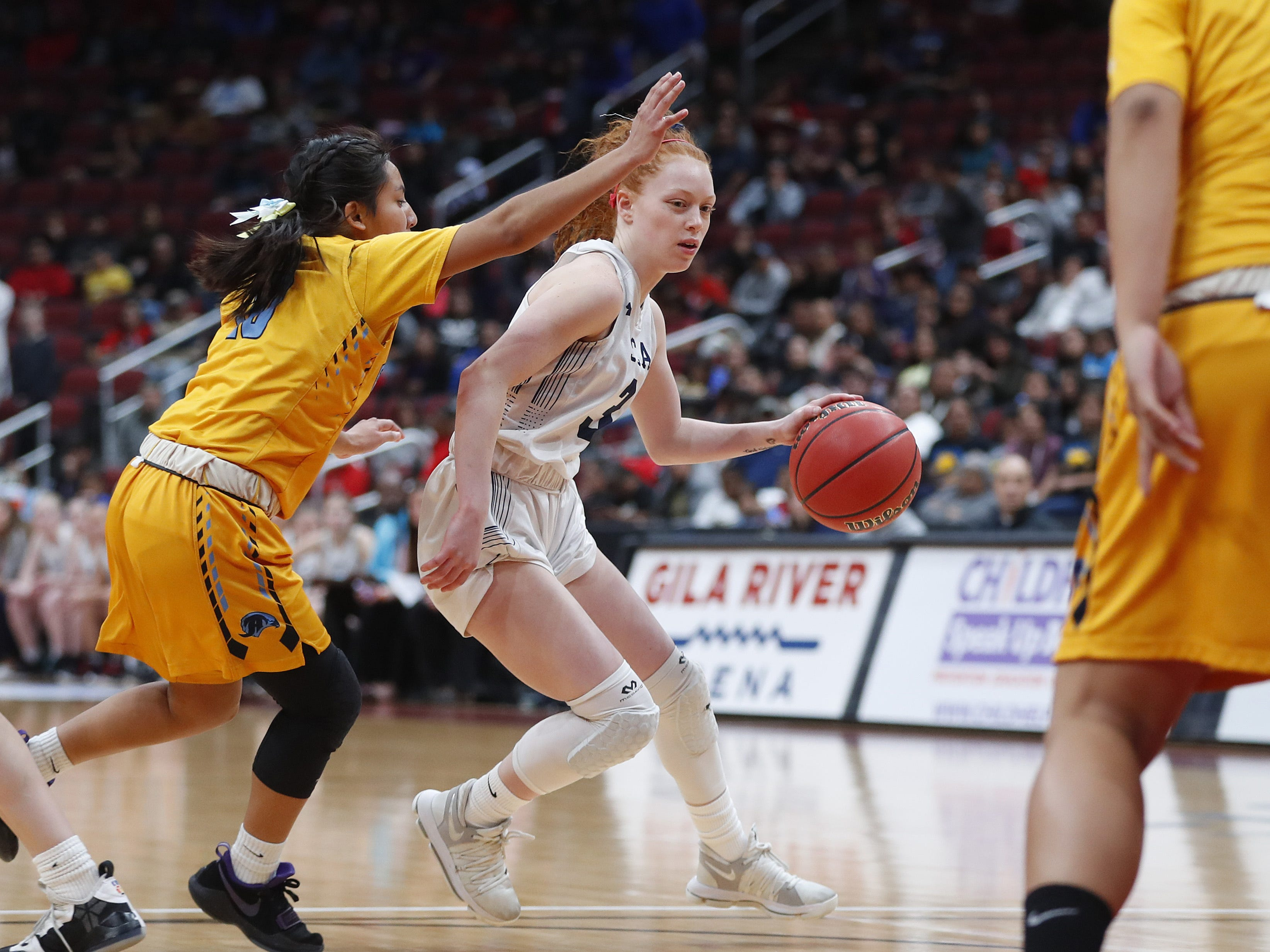 Scottsdale Christian's Kylie Hearn (3) dribbles against Alchesay's Denisia Massey (10) during the first half of the 2A girls basketball state championship game at Gila River Arena in Glendale, Ariz. on February 23, 2019.