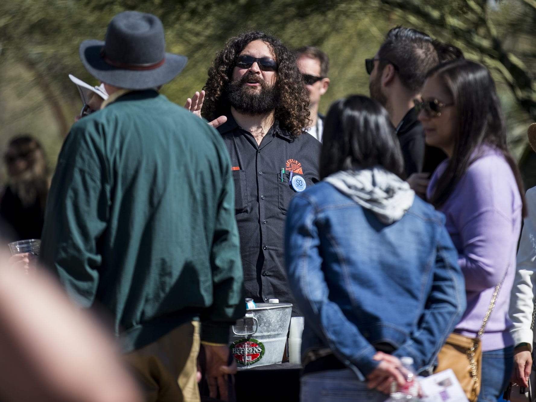 Evan Luthye of Mother Road Brewing talks to people during Day 1 of the Devour Culinary Classic on Saturday, Feb. 23, 2019, at Desert Botanical Garden in Phoenix.