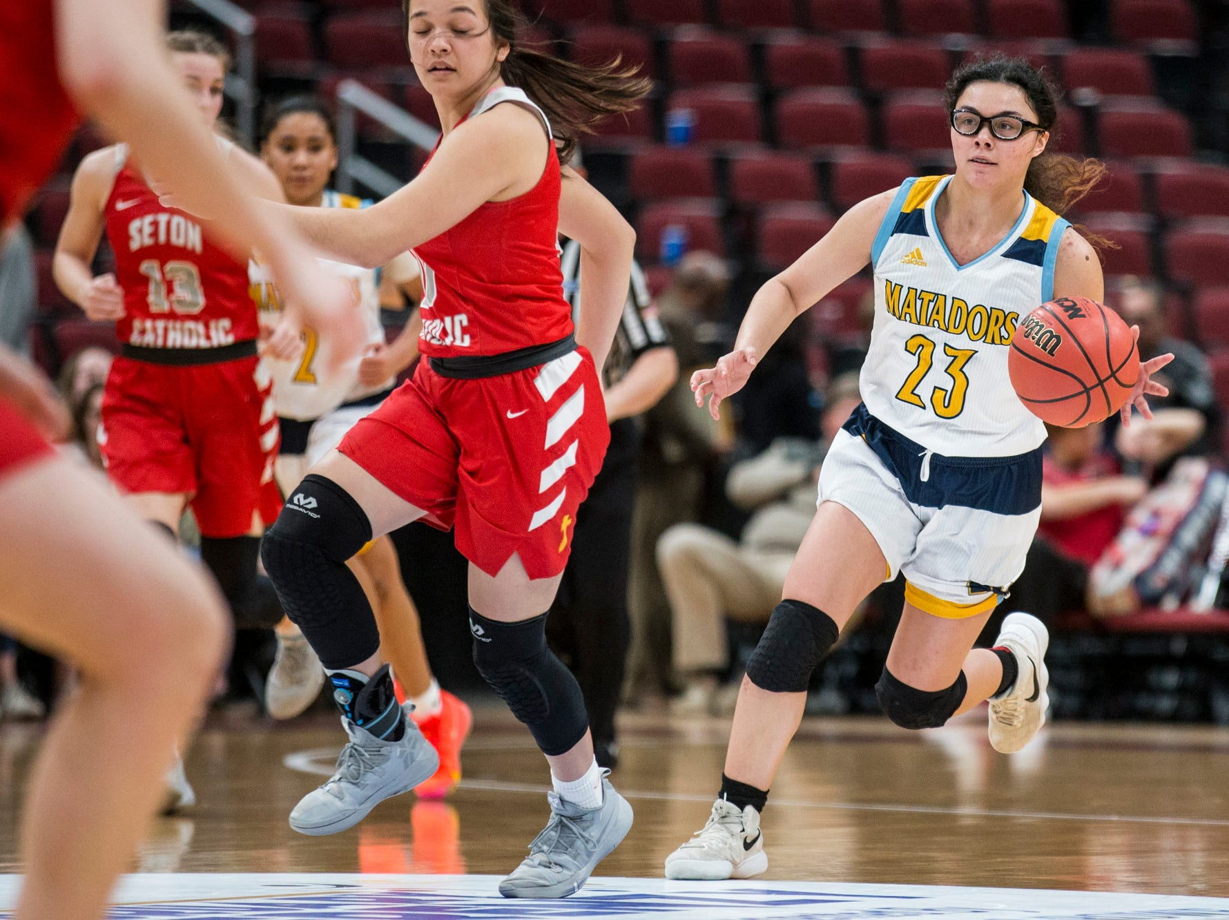 Shadow Mountain's Sissy Paloma drives downcourt against Seton Catholic during the 4A girls basketball championship on Saturday, Feb. 23, 2019, at Gila River Arena in Glendale, Ariz.