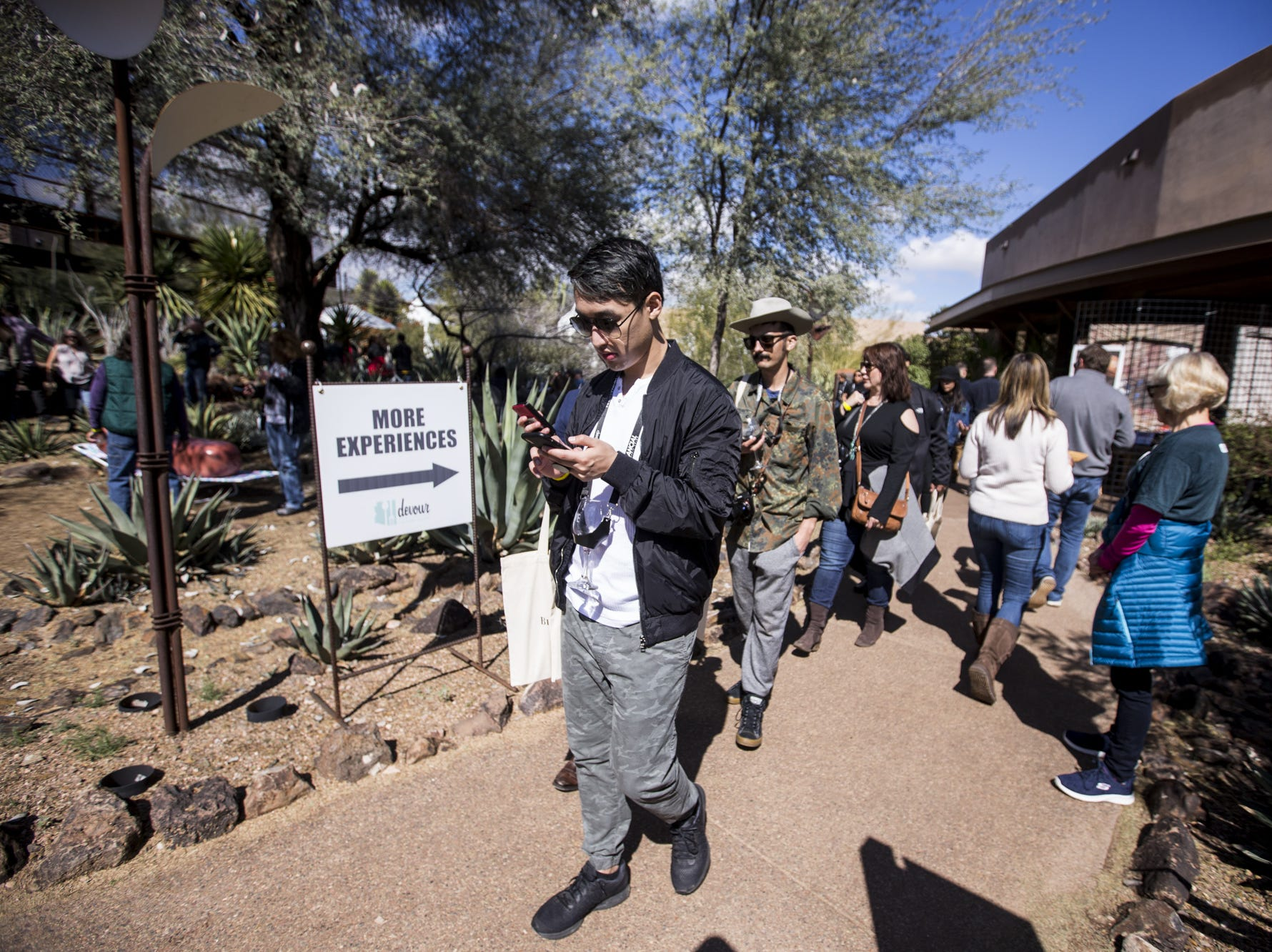 People walk during Day 1 of the Devour Culinary Classic on Saturday, Feb. 23, 2019, at Desert Botanical Garden in Phoenix.