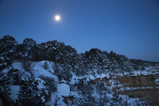 The full moon sets at Mather Point at the South Rim of Grand Canyon National Park, Ariz., on Feb. 20, 2019. The temperature at sunrise was 2 degrees.