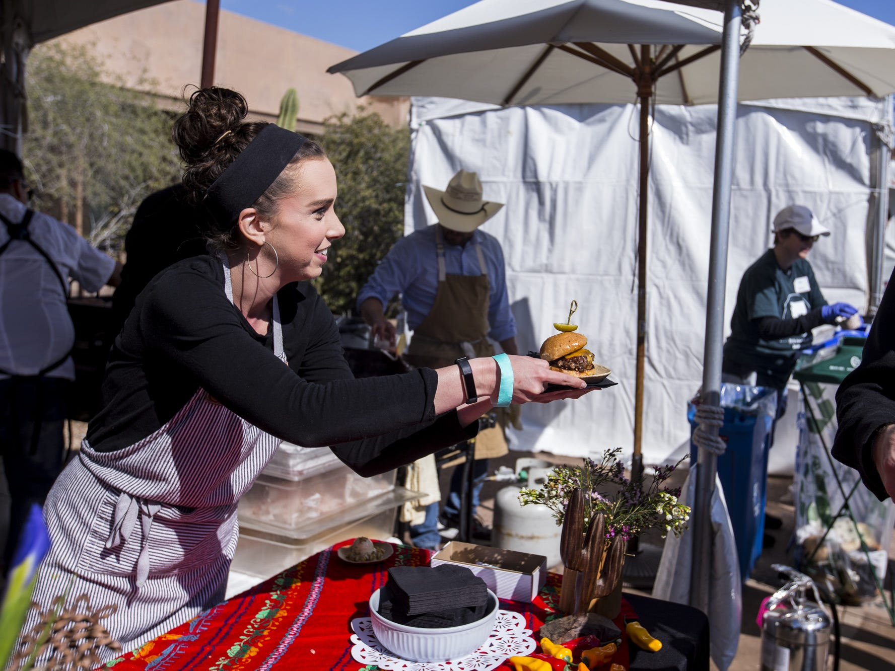 Janessa Hilliard of Otro Cafe gives out samples during Day 1 of the Devour Culinary Classic on Saturday, Feb. 23, 2019, at Desert Botanical Garden in Phoenix.