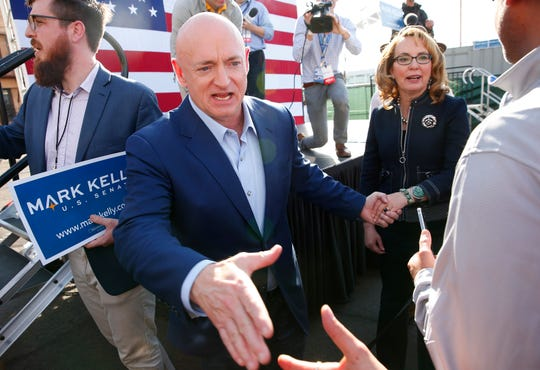 Mark Kelly, along with his wife, former U.S. Rep. Gabrielle Giffords, greets supporters during a Senate campaign launch event in Phoenix on Feb. 24, 2019. Kelly is running as a Democrat for the late U.S. Sen. John McCain's seat.