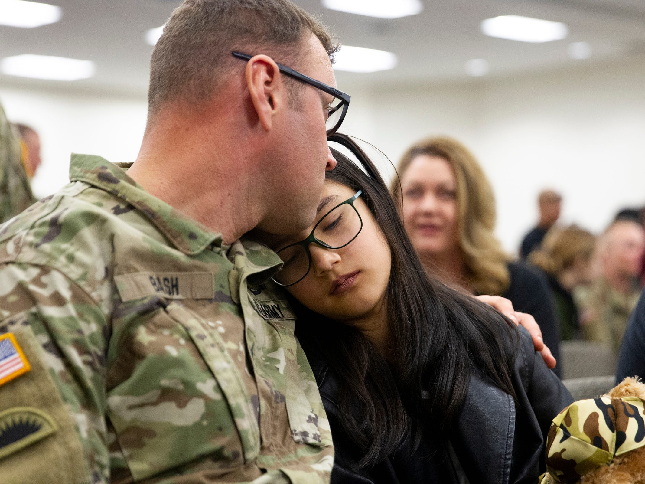Dan Bash spends a moment with his 11-year-old daughter Ophelia Bash before the deployment ceremony of the 253rd Engineer Battalion at Papago Park Military Reservation on Sunday, Feb. 24, 2019. The soldiers boarded buses immediately after the ceremony.