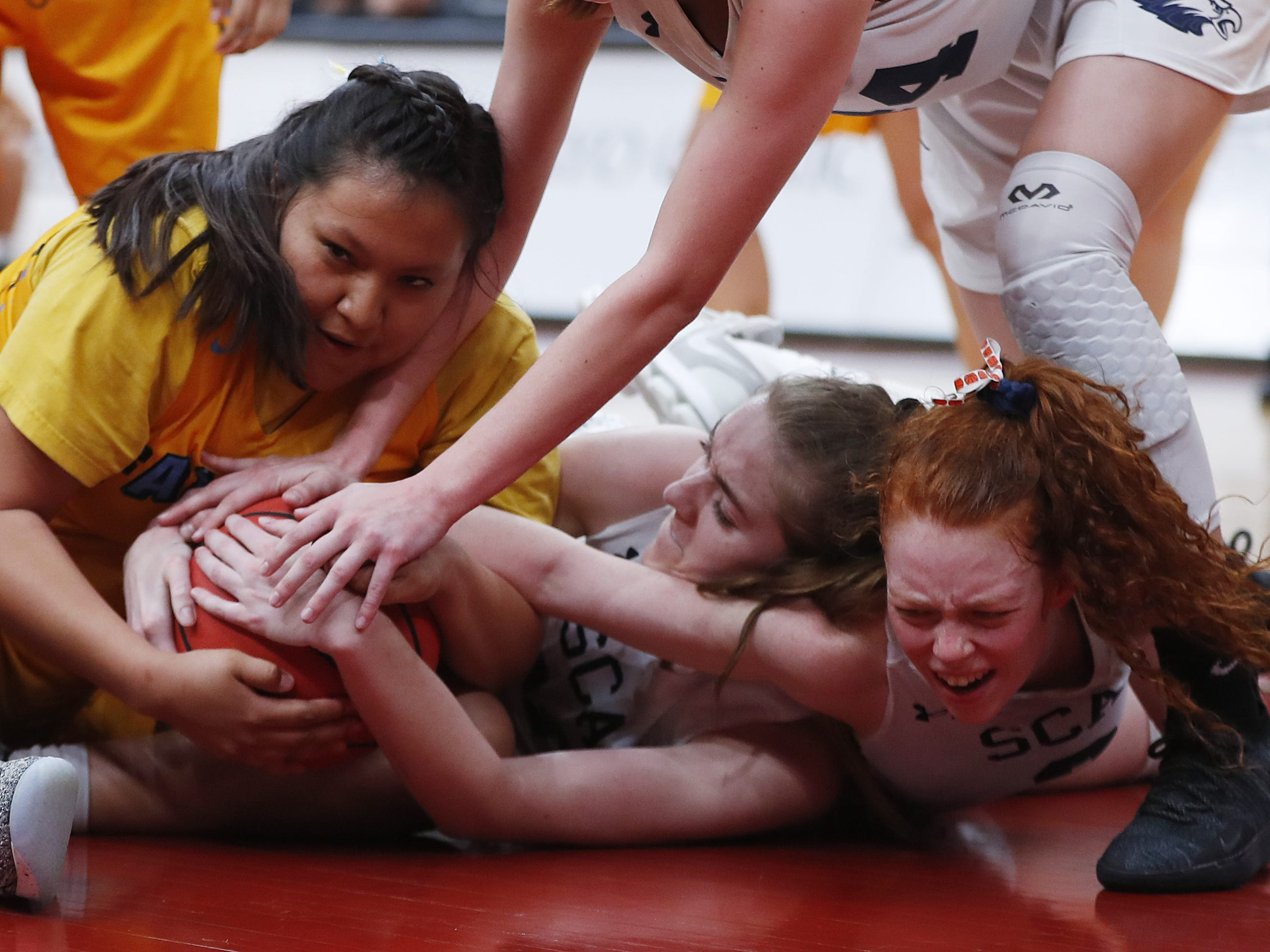 Alchesay's Vercelia Martinez (30) and Scottsdale Christian's Kylie Hearn (3) tie up the loose ball during the second half of the 2A girls basketball state championship game at Gila River Arena in Glendale, Ariz. on February 23, 2019.
