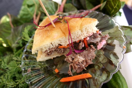 Italian beef sandwich with slow roasted beef, house made focaccia and house made giardiniera from Merkin Vineyards Osteria at the 2019 Devour Culinary Classic at the Desert Botanical Garden in Phoenix.