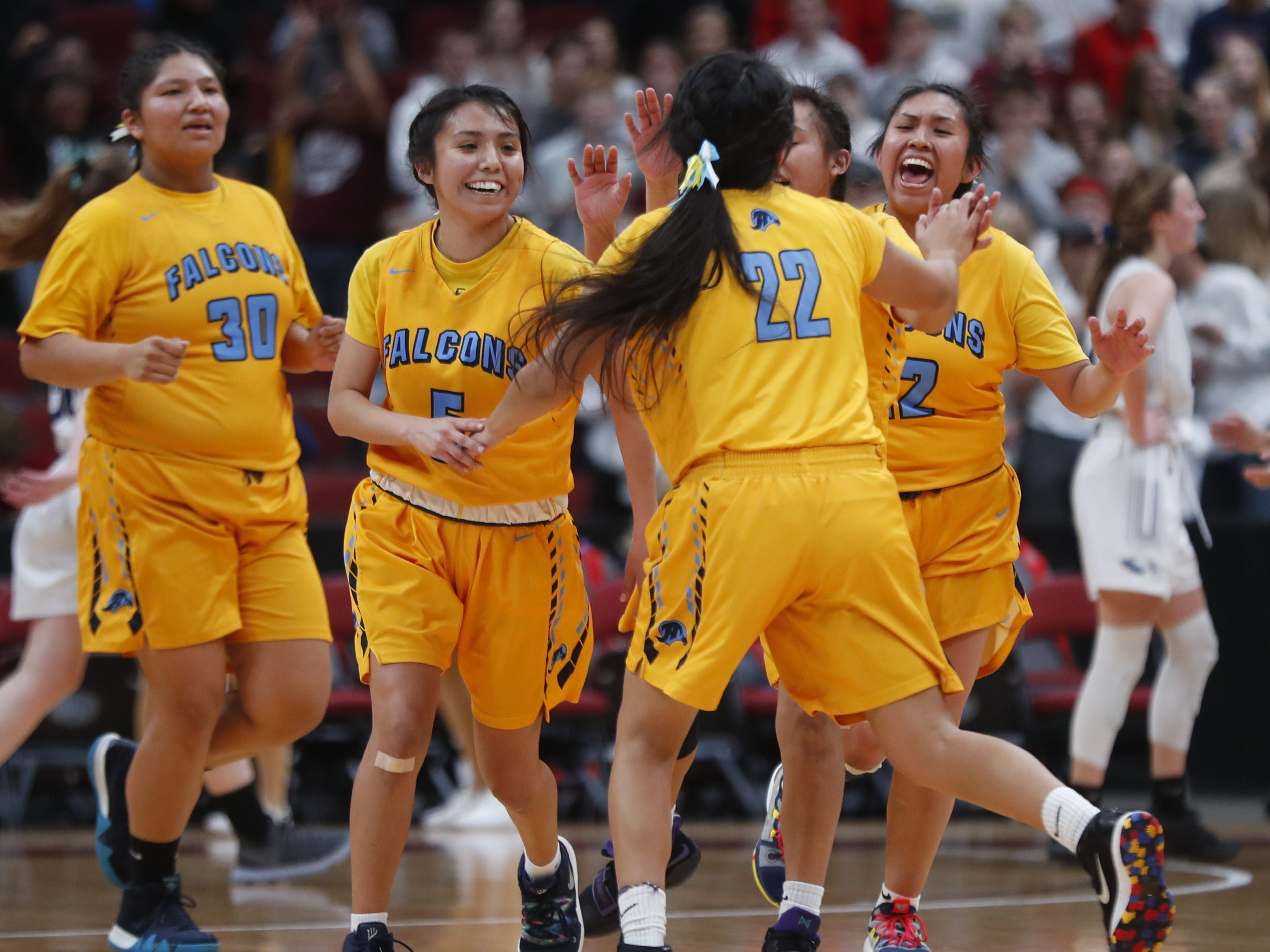 Alchesay's Laney Lupe celebrates with her teammates after hitting a three pointer during the second half against Scottsdale Christian during the 2A girls basketball state championship game at Gila River Arena in Glendale, Ariz. on February 23, 2019.