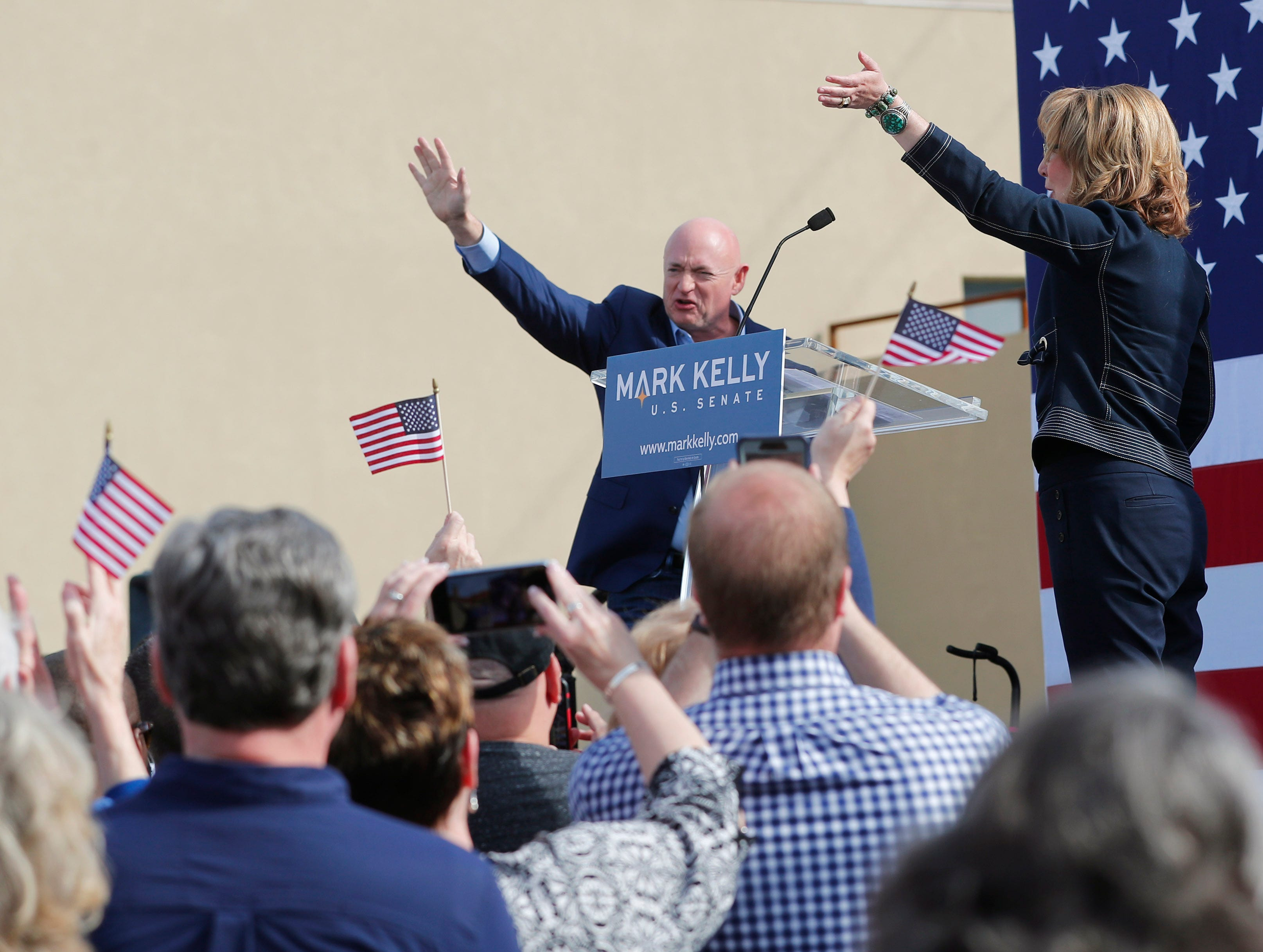 Mark Kelly is introduced by his wife, Gabrielle Giffords, during a Senate launch event in Phoenix, Ariz. on Feb. 24, 2019. Kelly is running as a Democrat for the late Sen. John McCain's seat.