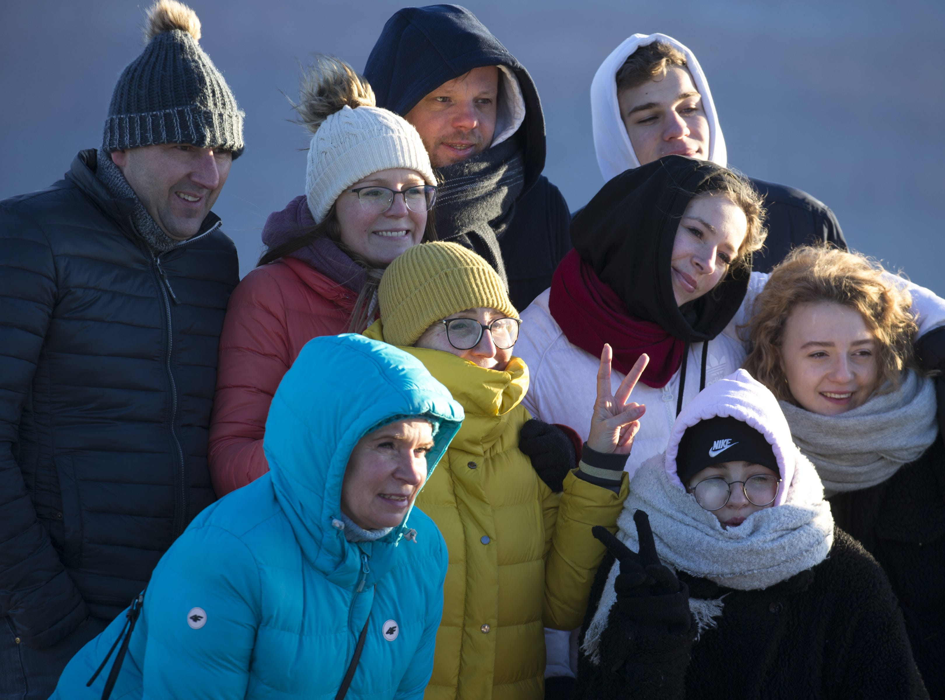 Visitors take a group photo at Mather Point at the South Rim of Grand Canyon National Park, Ariz, on Feb. 20, 2019