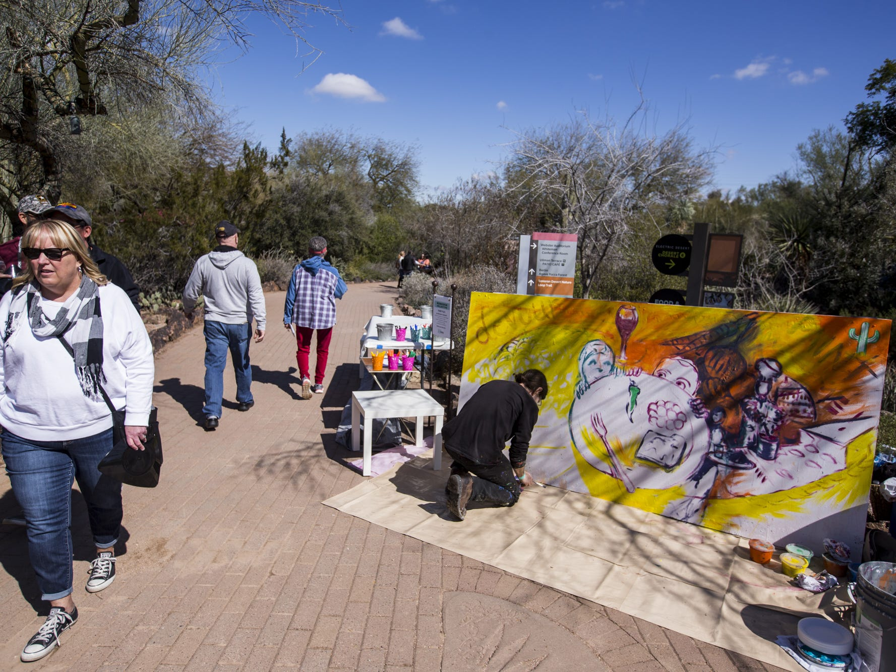 Michael B. Schwartz works on a painting during Day 1 of the Devour Culinary Classic on Saturday, Feb. 23, 2019, at Desert Botanical Garden in Phoenix.