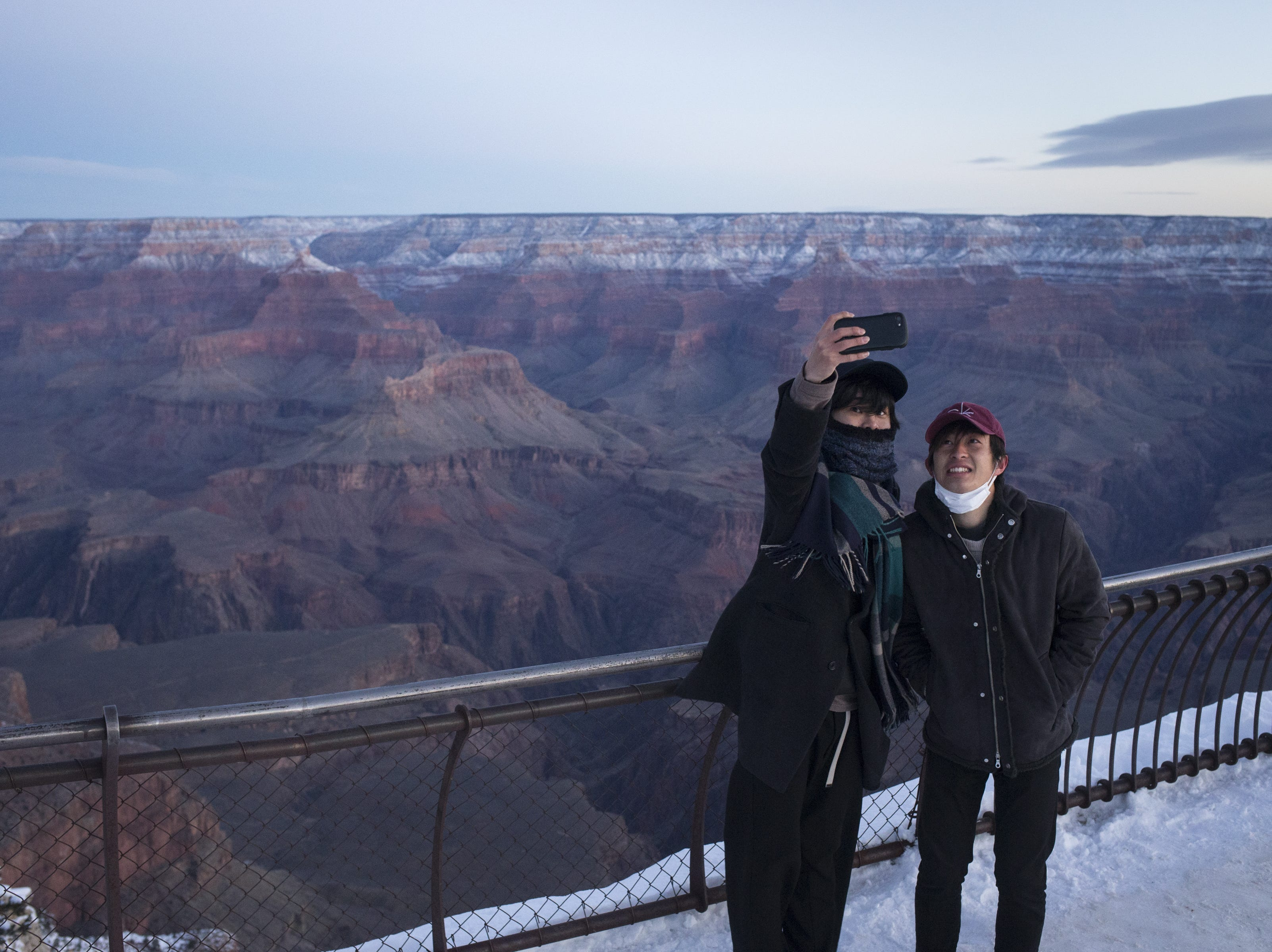 Visitors take a selfie at Mather Point at the South Rim of Grand Canyon National Park, Ariz., at Feb. 20, 2019.