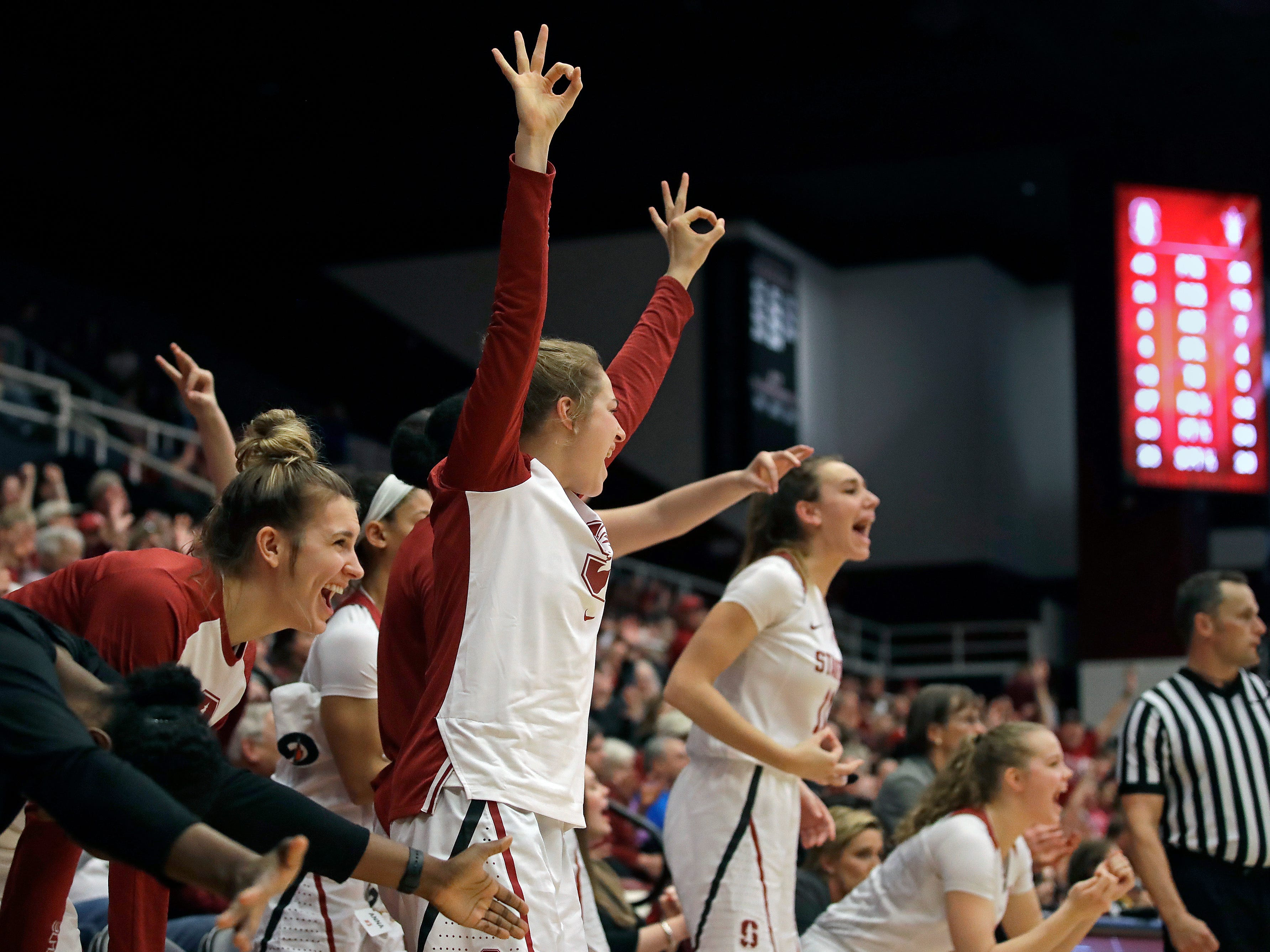 Players on the Stanford bench celebrate a score against Arizona State in the second half of an NCAA college basketball game Sunday, Feb. 24, 2019, in Stanford, Calif.