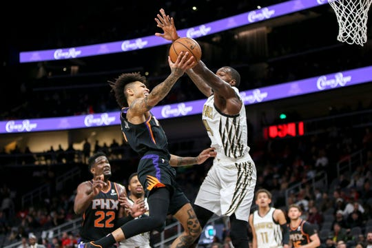 Feb 23, 2019: Phoenix Suns forward Kelly Oubre Jr. (3) is blocked by Atlanta Hawks center Dewayne Dedmon (14) in the first quarter at State Farm Arena.