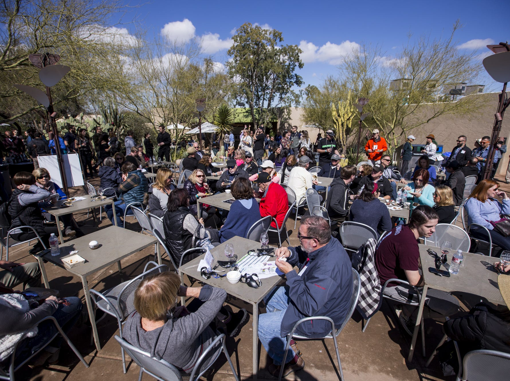People sample food during Day 1 of the Devour Culinary Classic on Saturday, Feb. 23, 2019, at Desert Botanical Garden in Phoenix.